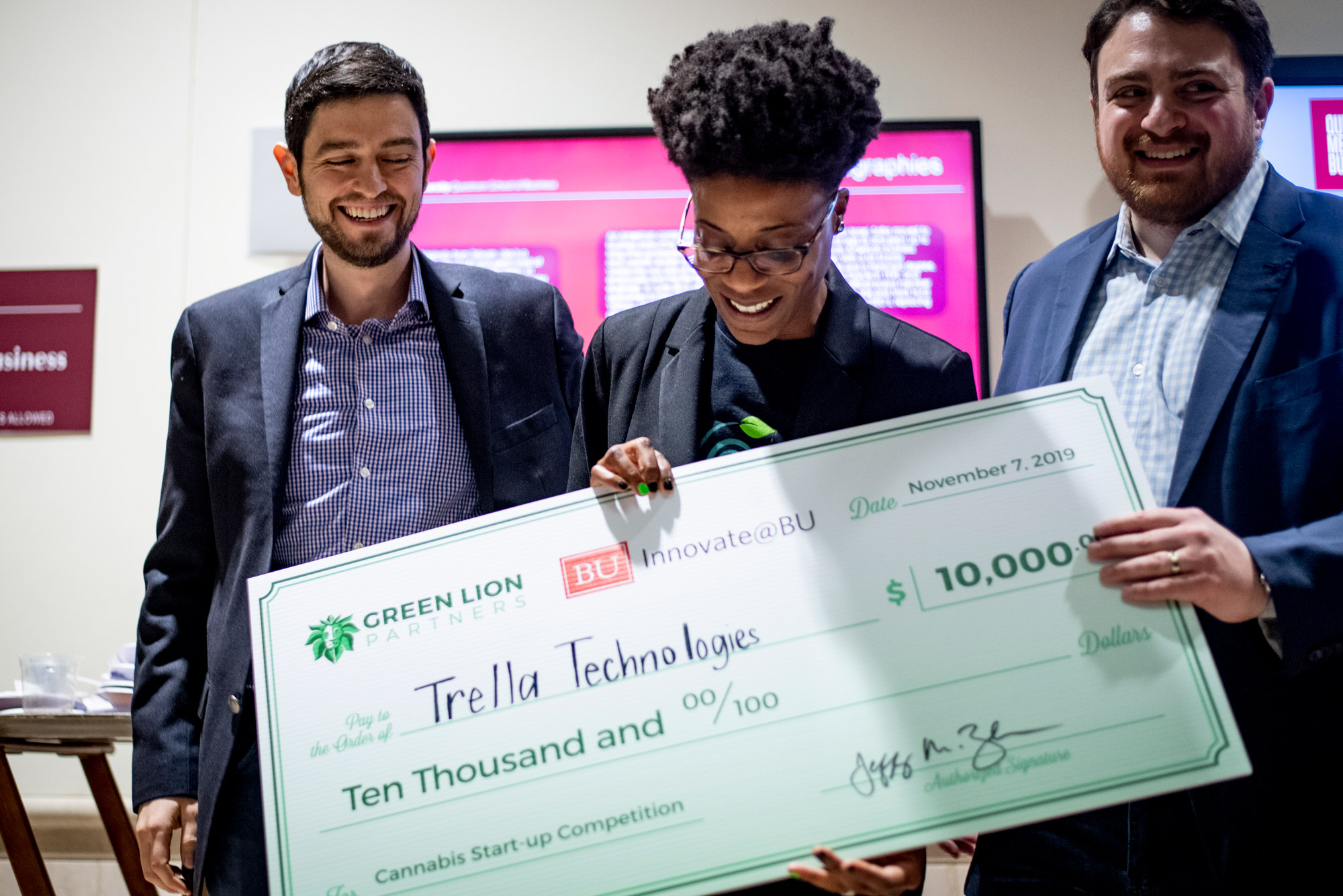 Angela Pitter (ENG'86) receives a check for $10,000 for her pitch for Trella Technologies, a horizontal plant-training system, during the 3rd Annual Cannabis Startup Competition