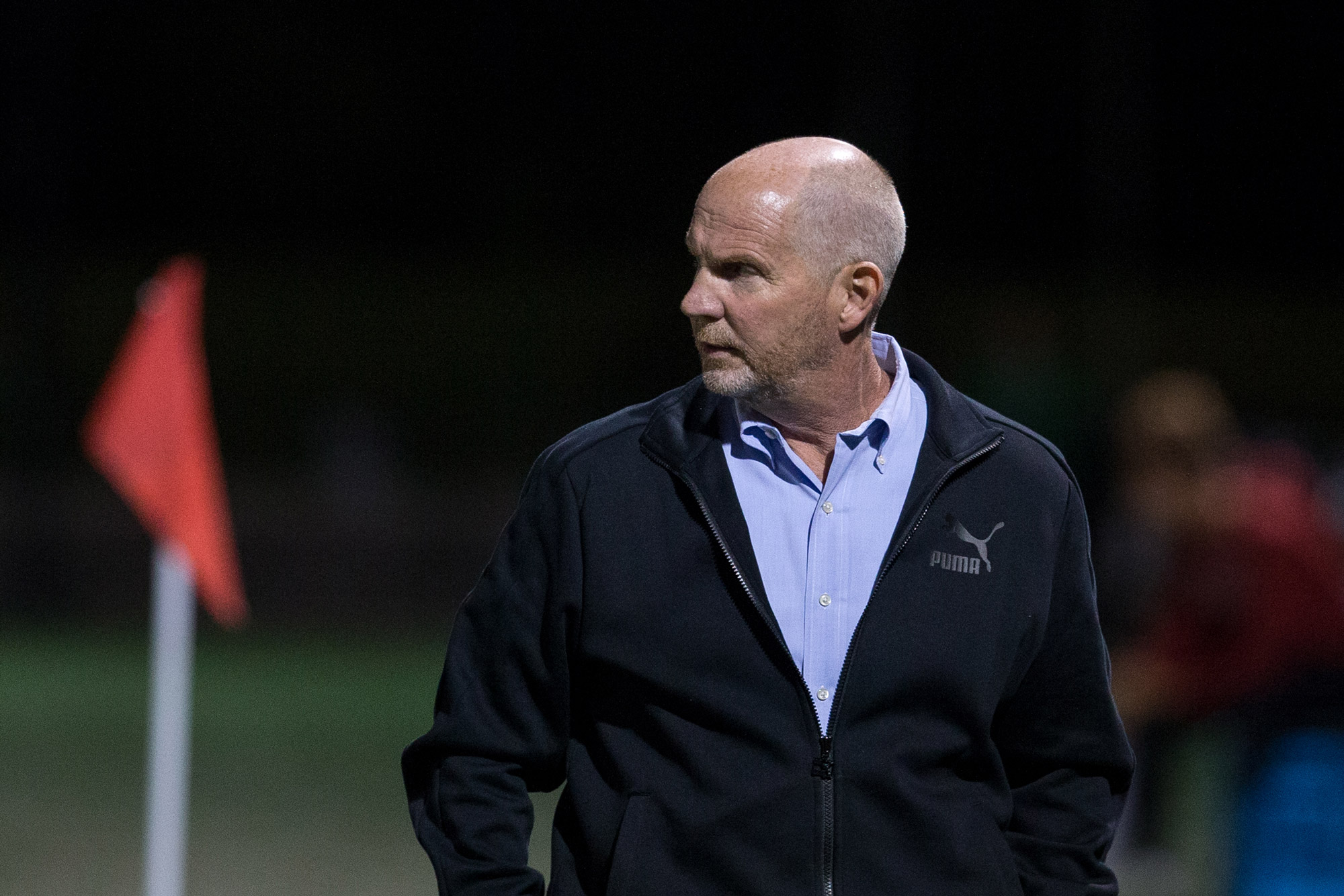 a photo of Neil Roberts, BU Men's Head Soccer Coach, on the field