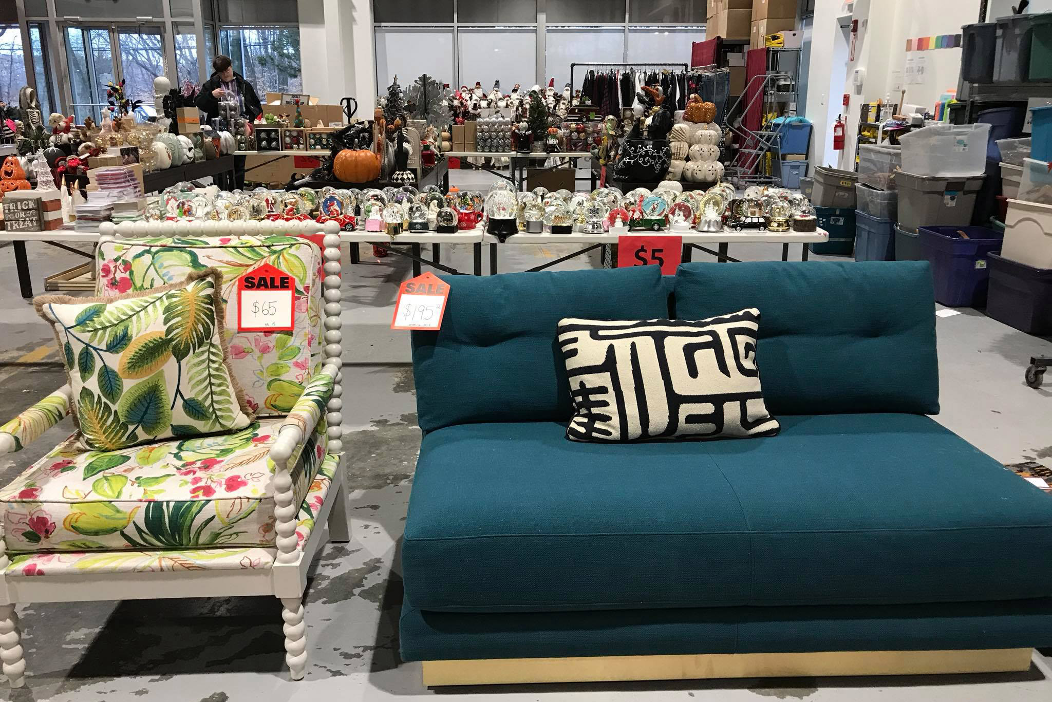 A couch, chair, and other knick knacks available for purchase at Boomerangs Special Edition