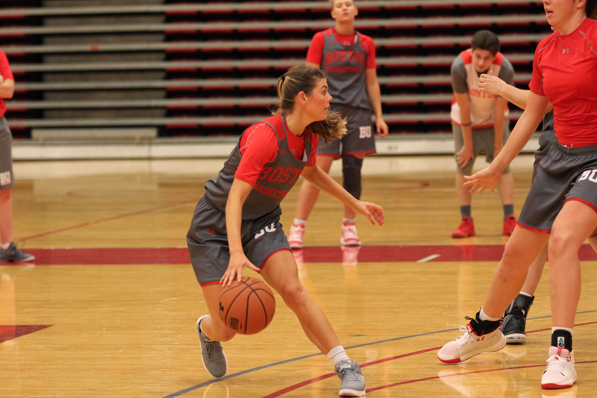 Katie Nelson (CGS'19, Questrom'21) dribbles a basketball