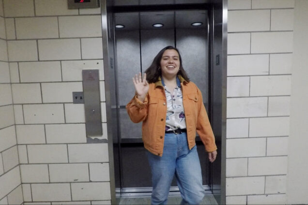 Temma Pelletier waves to the camera as she exits an elevator.