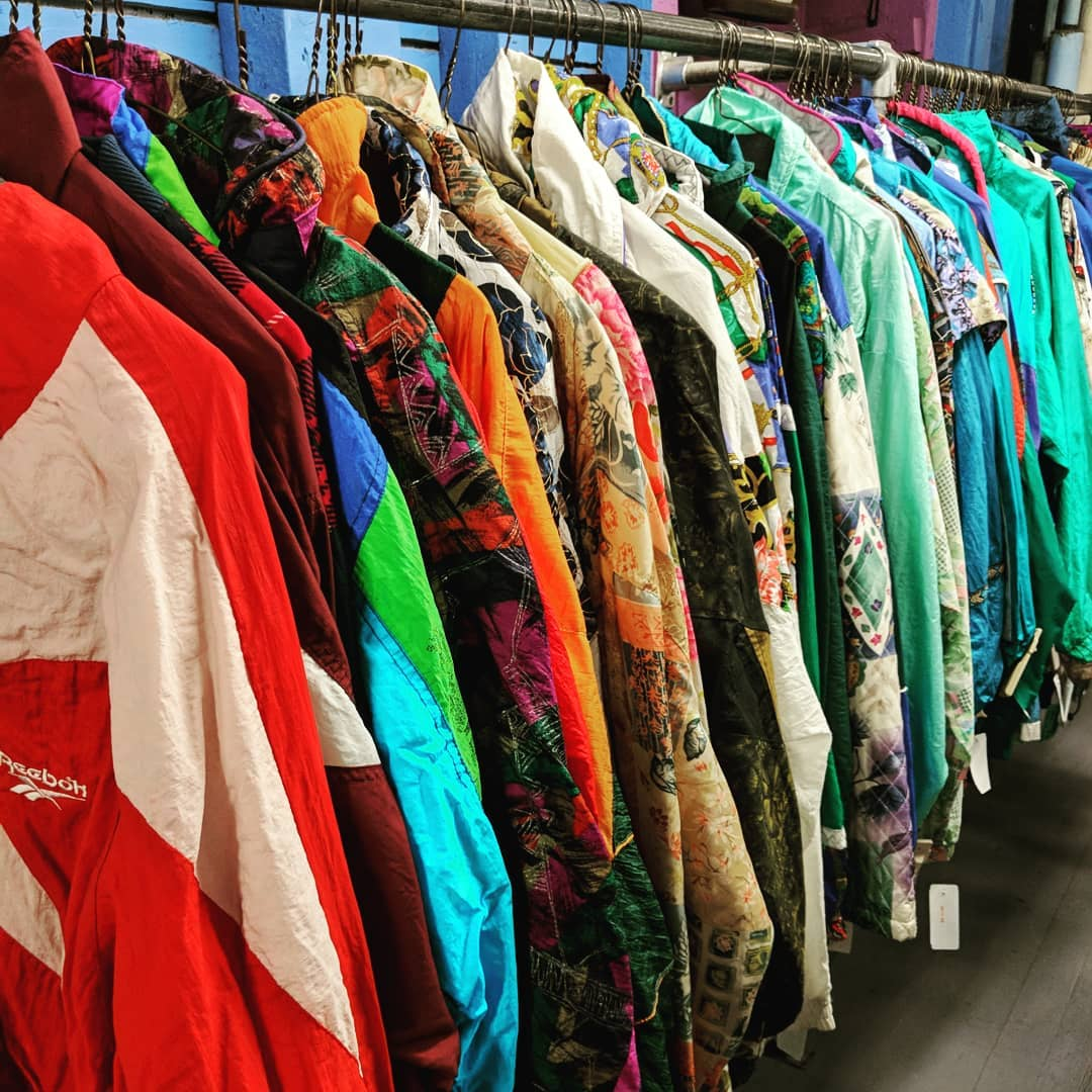 colorful jackets hanging in the Garment District consignment shop