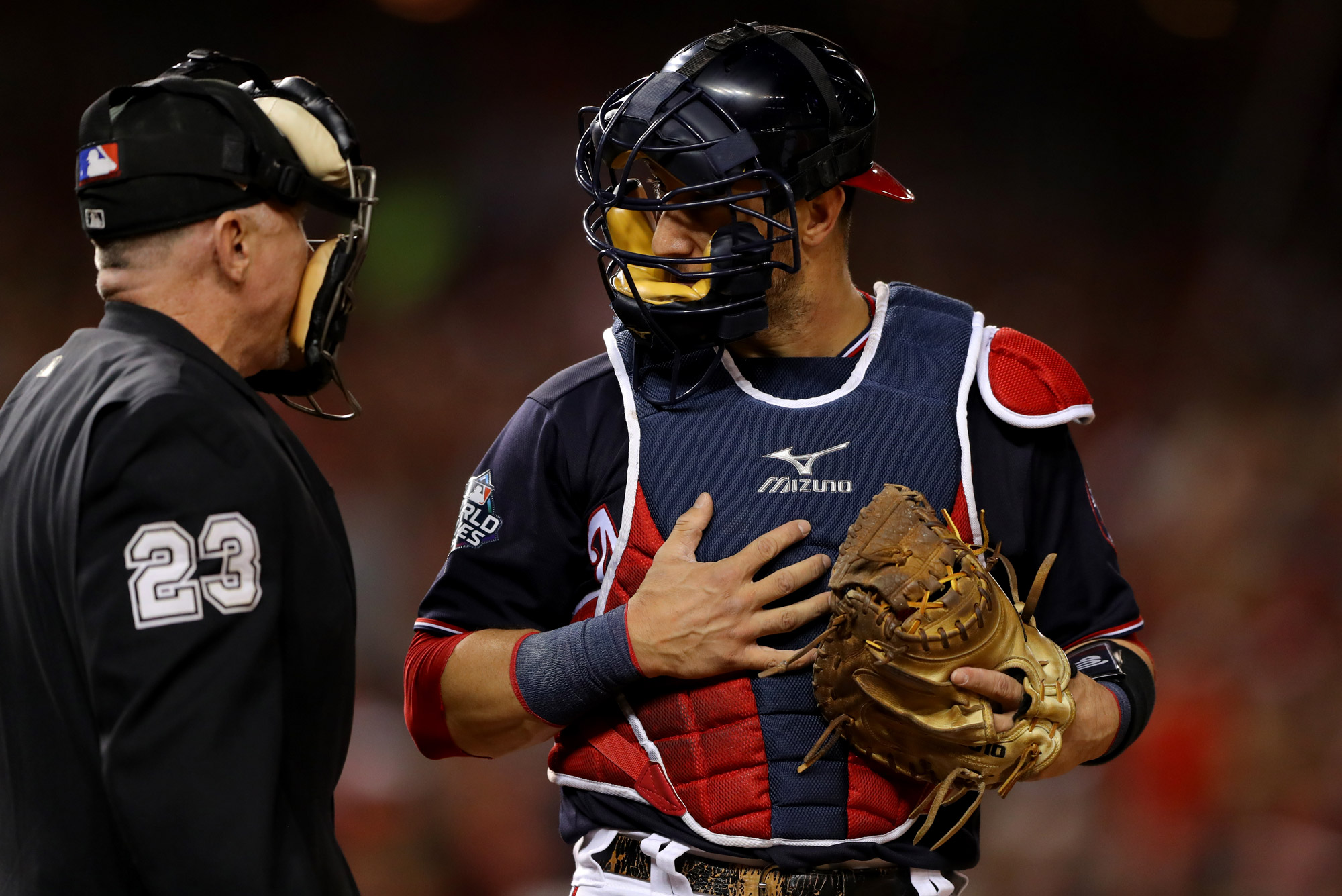 Yan Gomes #10 of the Washington Nationals argues a call with Home Plate umpire Lance Barksdale #23 during Game 5 of the 2019 World Series between the Houston Astros and the Washington Nationals