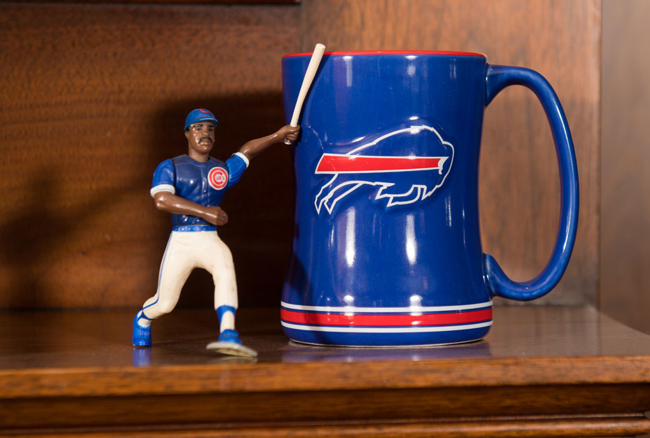 Chicago Cubs action figure and Buffalo Bills mug