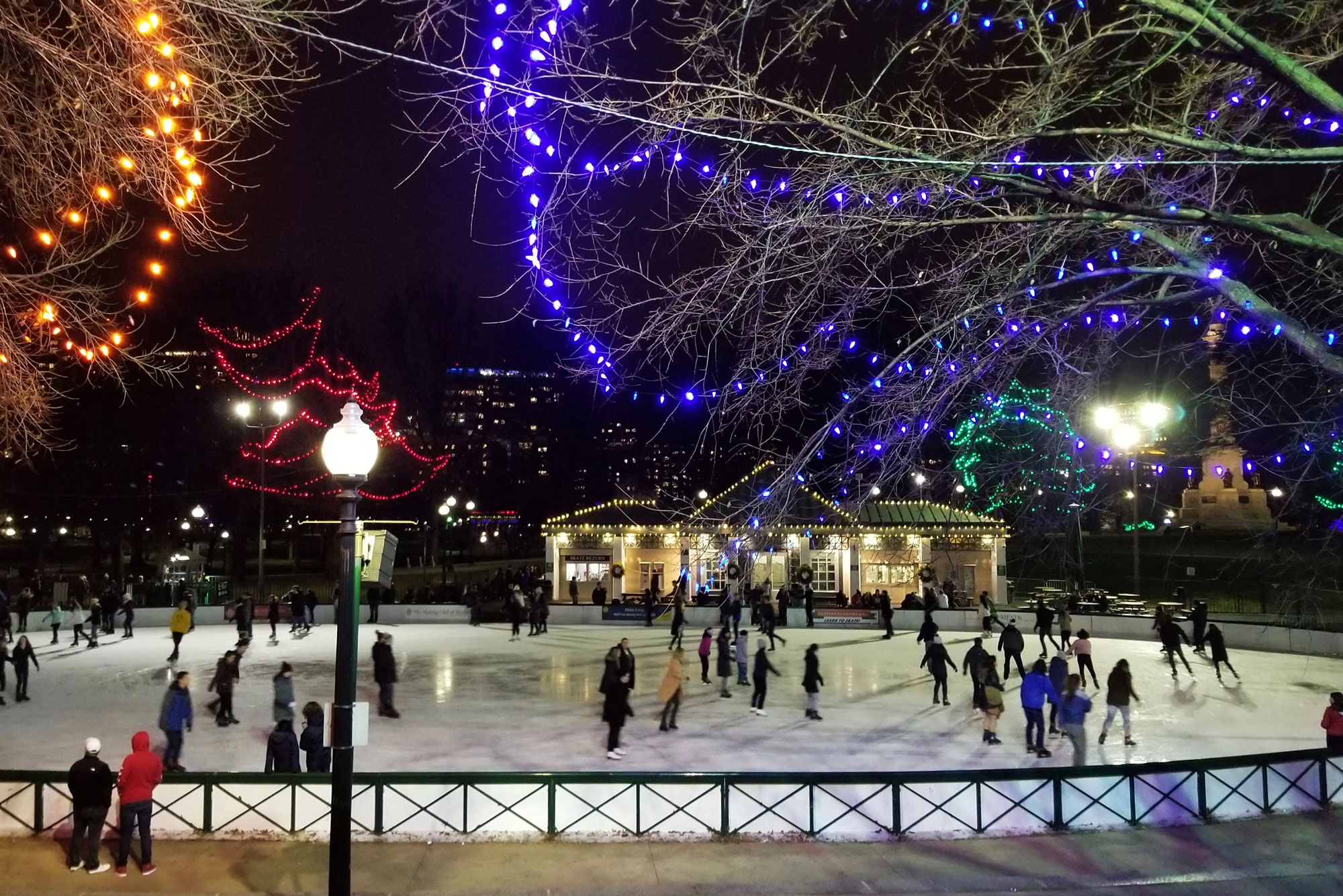 People skate on the Boston Frog Pond at Nighttime
