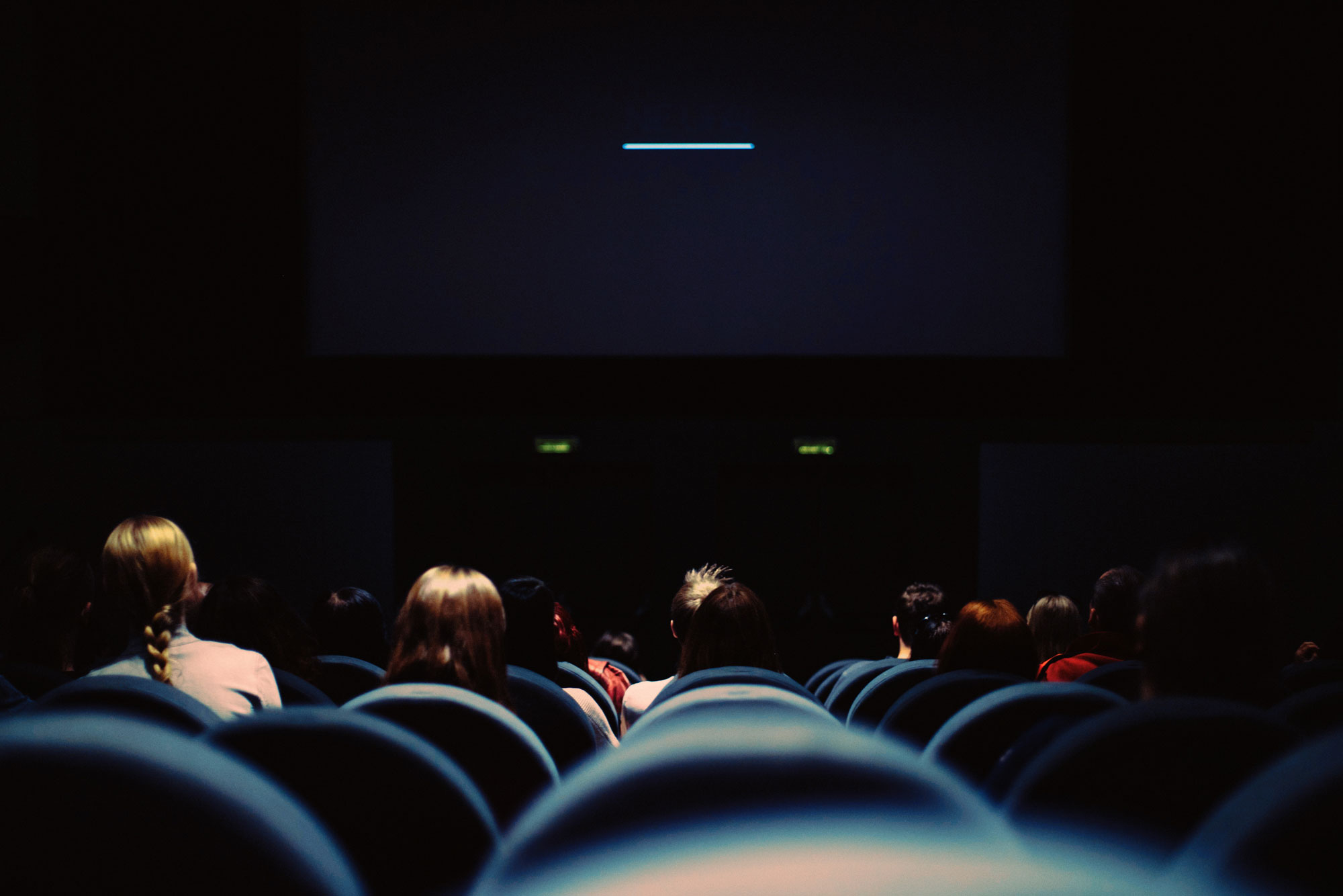 People sit in a movie theatre