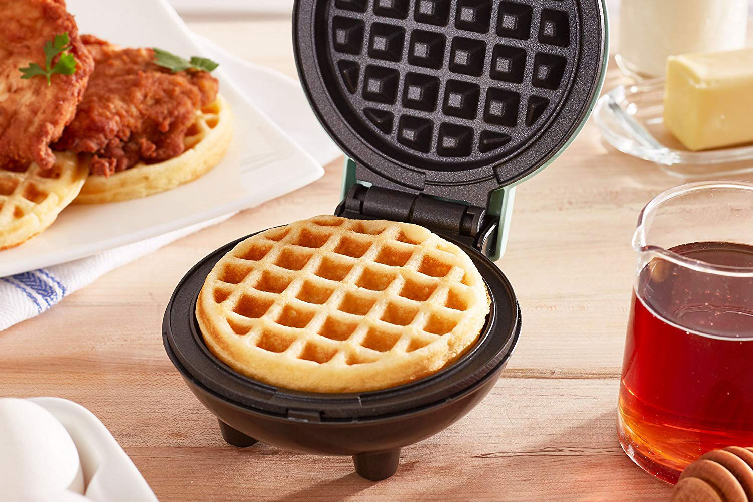 A waffle-maker sits on a table
