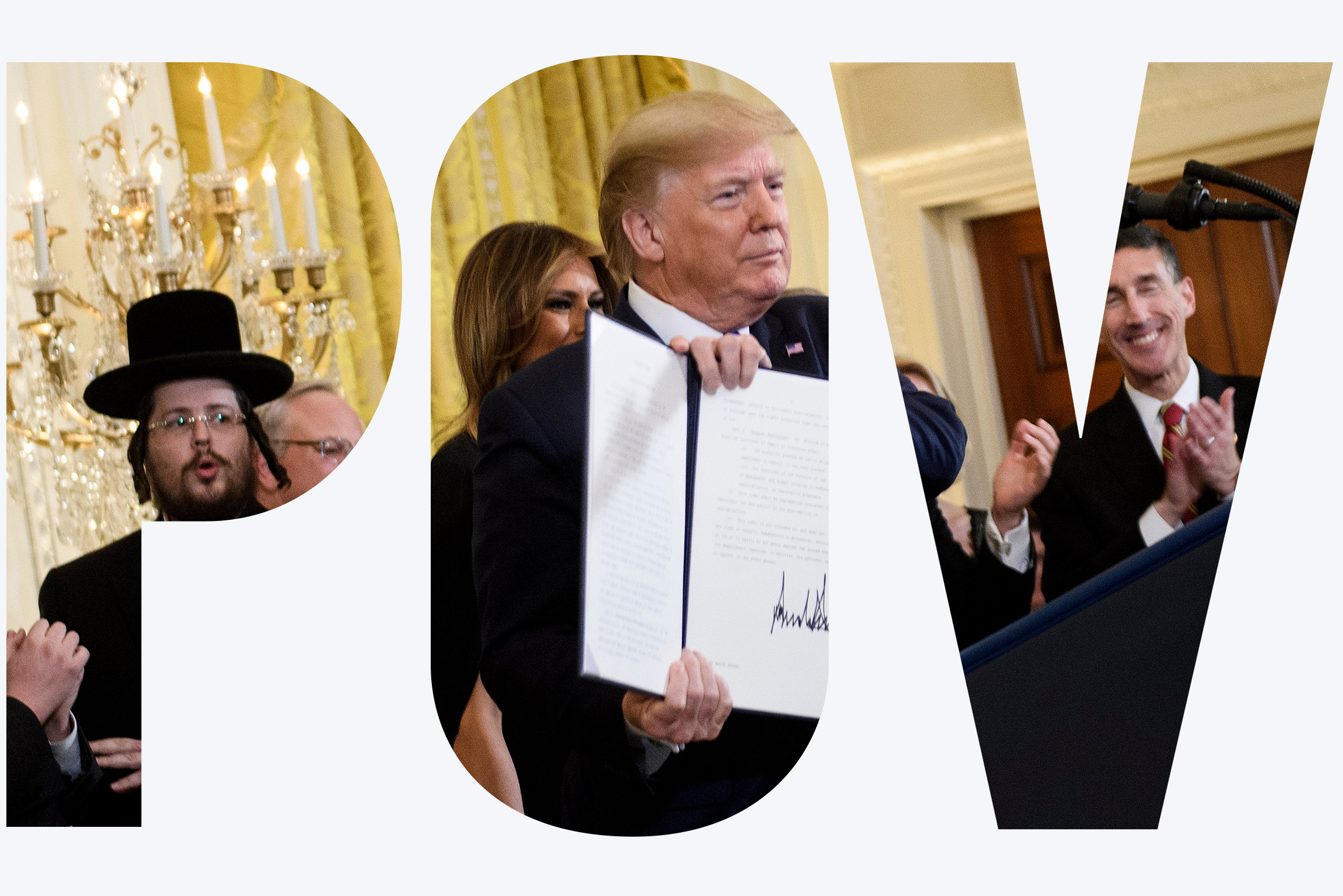 US President Donald Trump shows an executive order regarding anti-semitism during a Hanukkah reception in the East Room of the White House December 11, 2019, in Washington, DC.