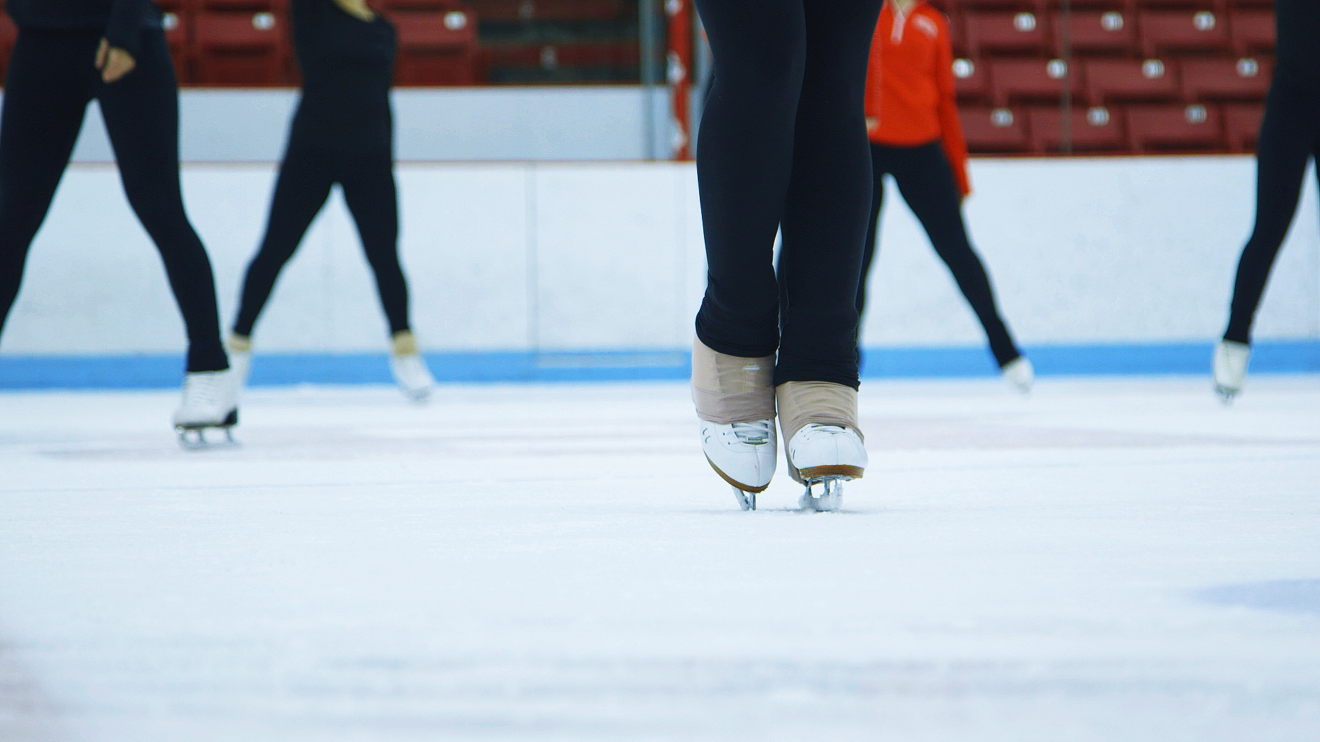 An ice skater skates on the rink in Agganis Areana