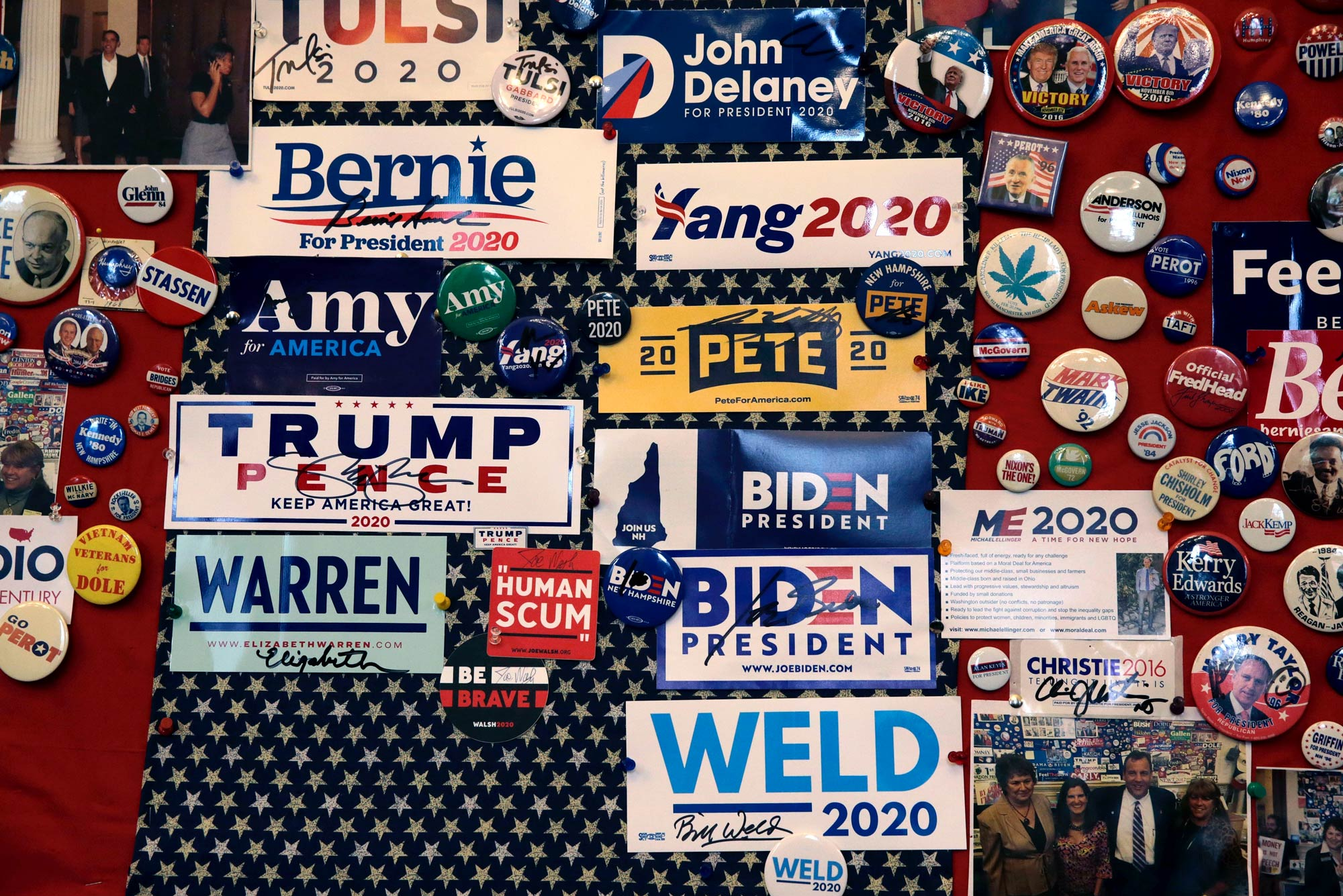 A collection of presidential candidate bumper stickers adorn a wall.