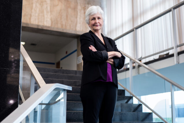 Senior advisor at the US Department of State, Jane Sigmon poses for a photo on a set of stairs