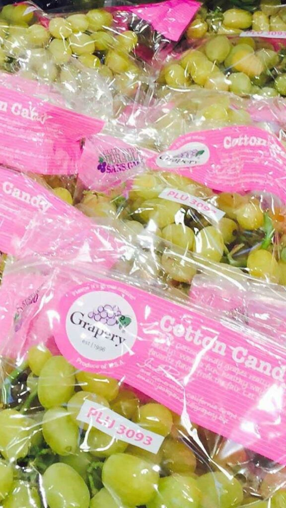 Bags of Cotton Candy Grapes on display in a groccery store