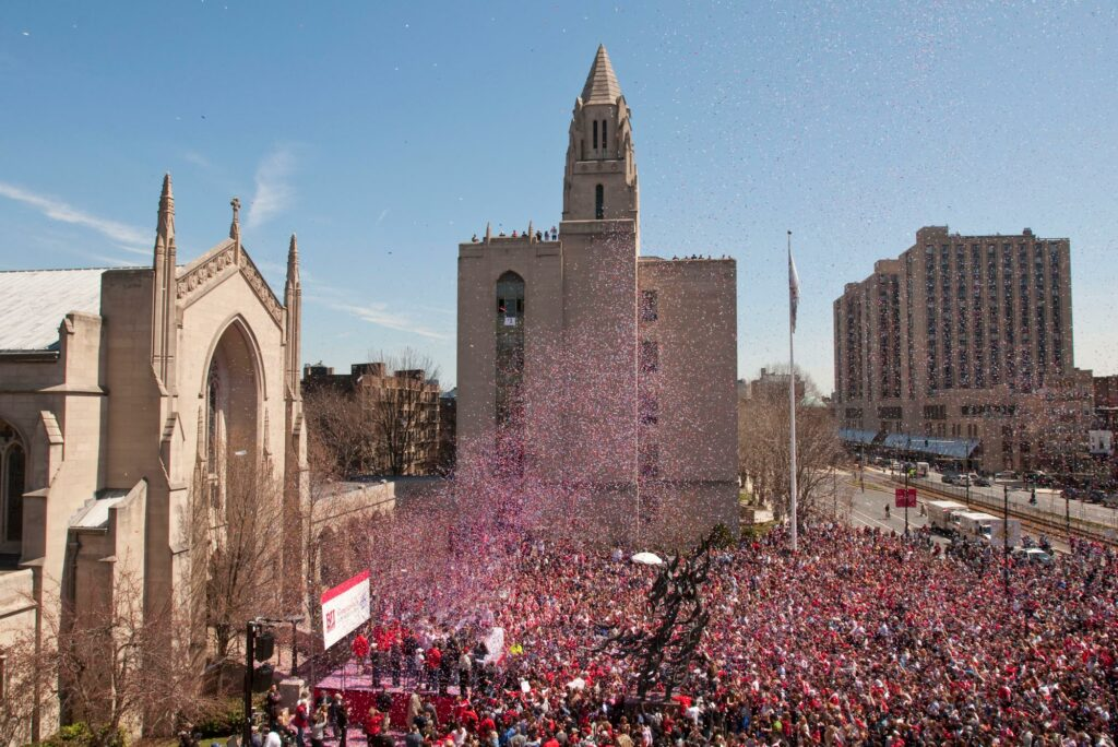 A photo of a celebration of the BU Men's Hockey 2009 national championship at Marsh Plaza