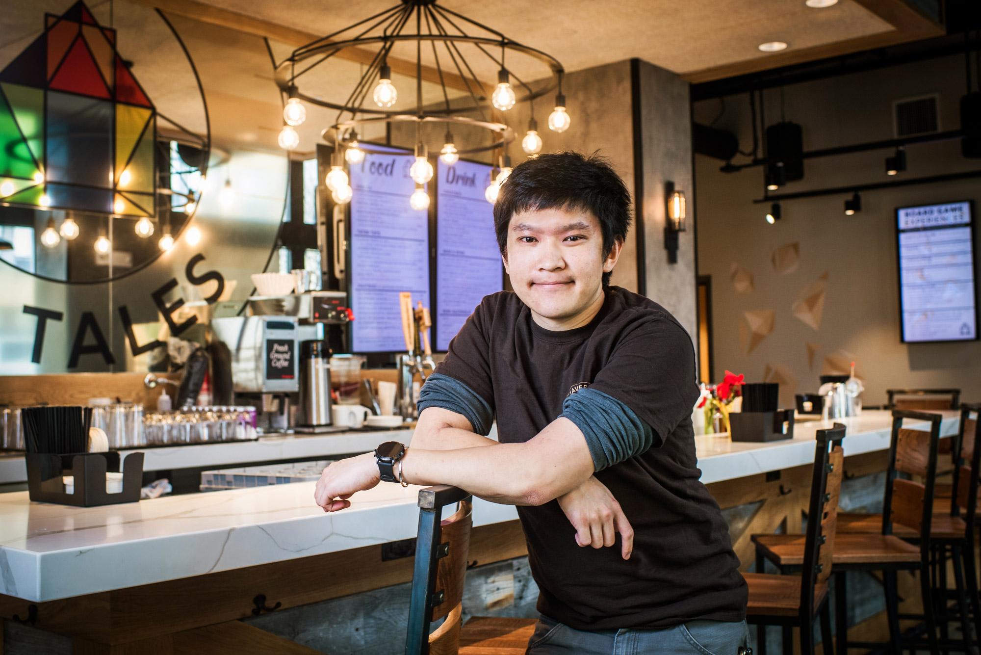 Nicholas Chen (CFA'17) poses for a photo inside his Board game café Tavern of Tales.