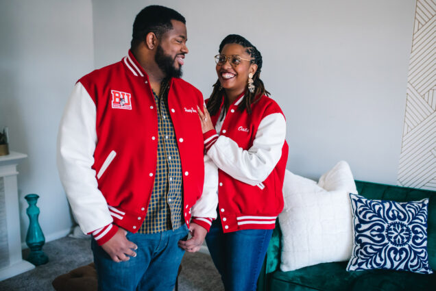 A photo of Joshua Reynolds (CFA'11, MET'13) and Danielle Galloway (CAS'15) wearing Boston University letterman's jackets