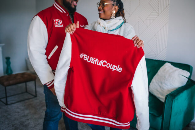 A photo of Joshua Reynolds (CFA'11, MET'13) and Danielle Galloway (CAS'15) with their Boston University letterman's jackets