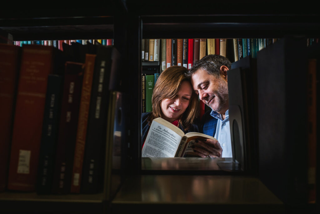 A photo of Anne (Salzberg) Olshan (CAS'89, COM'89) and John Olshan (CGS'87, CAS'89) in the stacks at Mugar Library