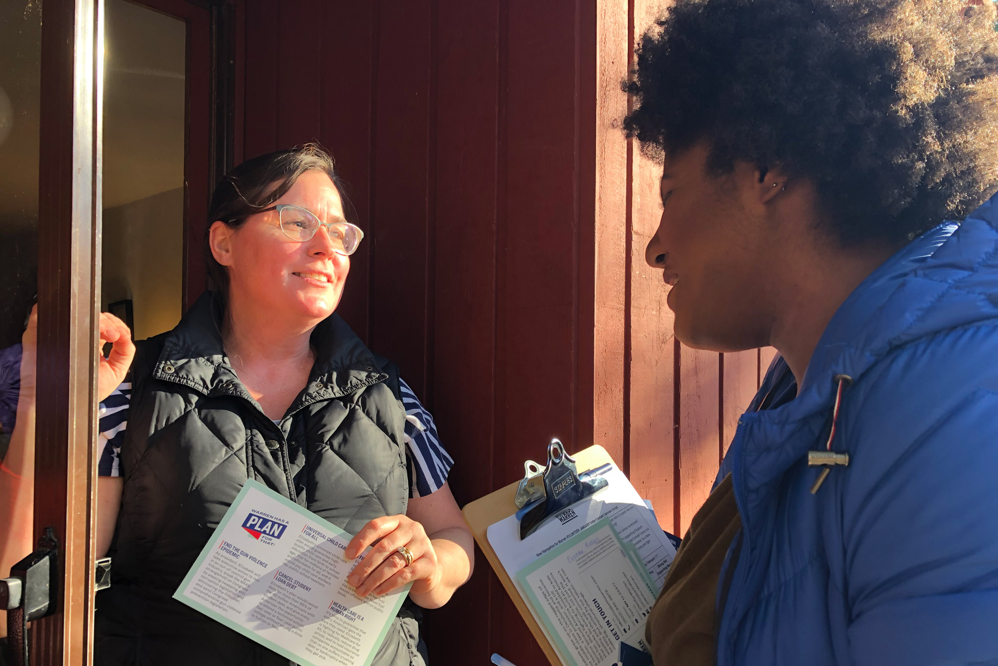 Niya Doyle (CGS'22) speaking with New Hampshire resident Katie Kelly while canvassing for Elizabeth Warren.