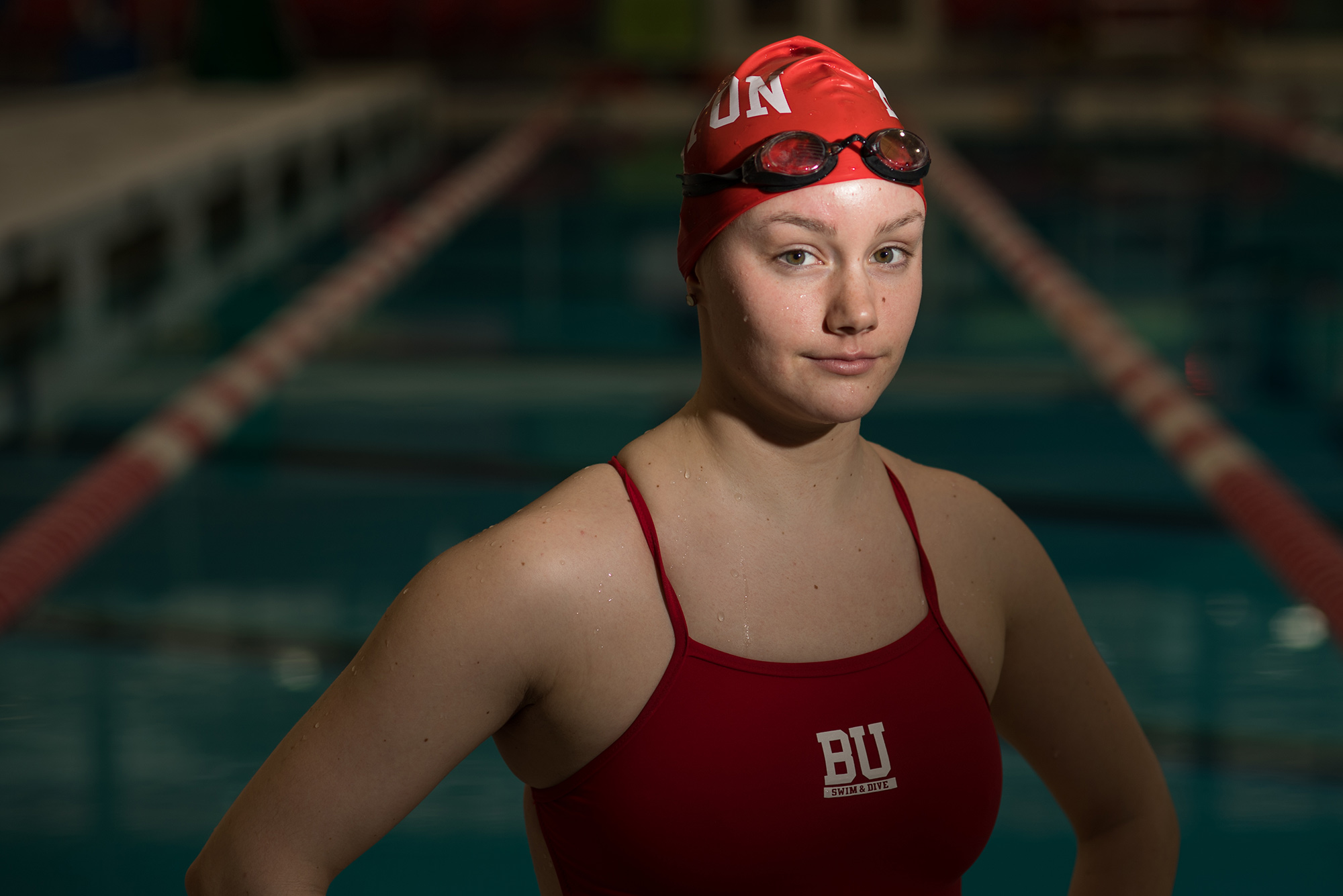 Portrait of swimmer Carly Soares (CFA'20) in front of pool.