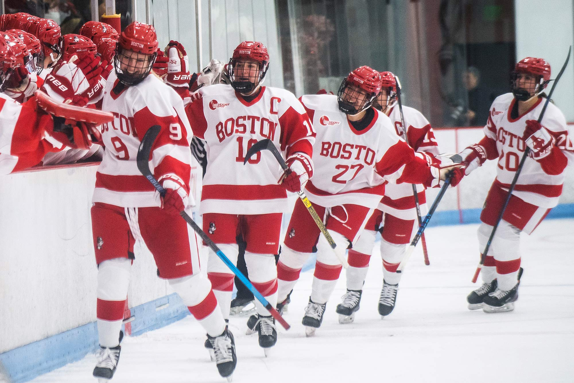 Members of BU's women's hockey team celebrate after scoring a goal in the first quarter against Boston College during the Women's Beanpot tournament on Tuesday, February, 4, 2020