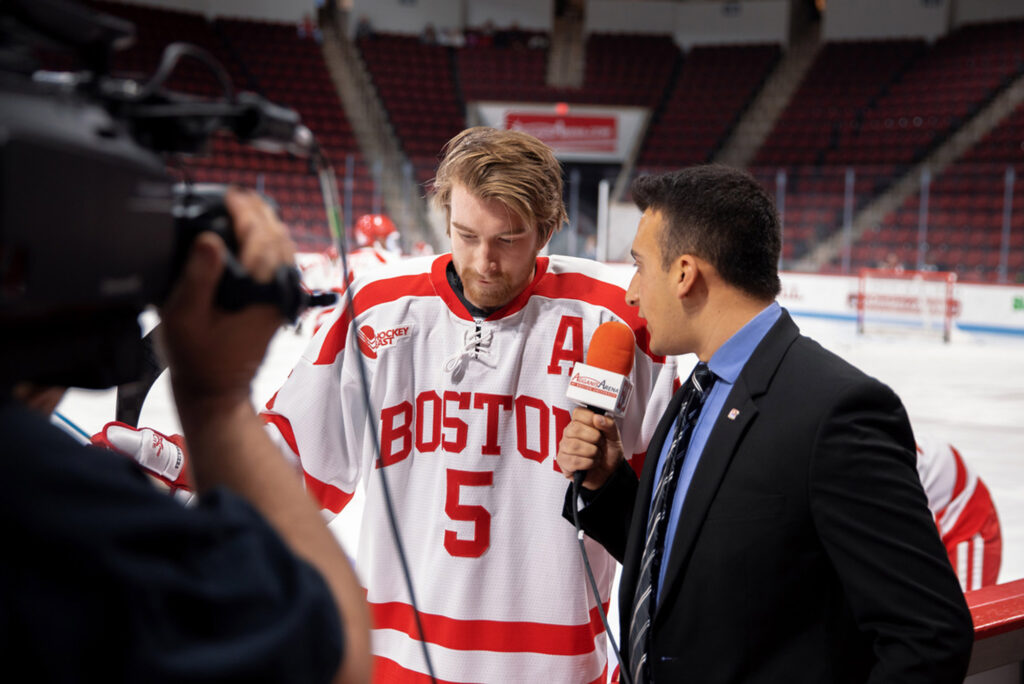 A photo of Levinsky interviewing  Cam Crotty (Questrom'21) during the game he spent as the men's ice hockey rinkside reporter.