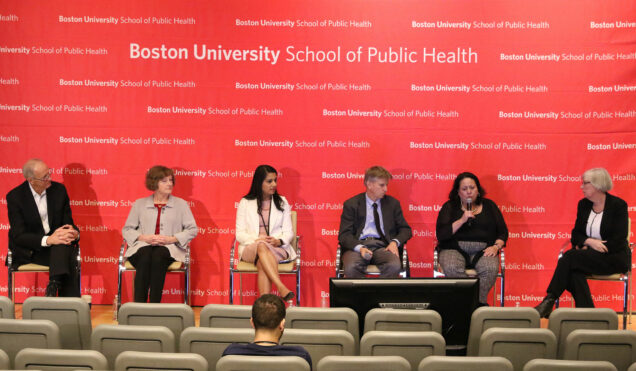 A photo of a panel at a symposium hosted by the School of Public Health on coronavirus