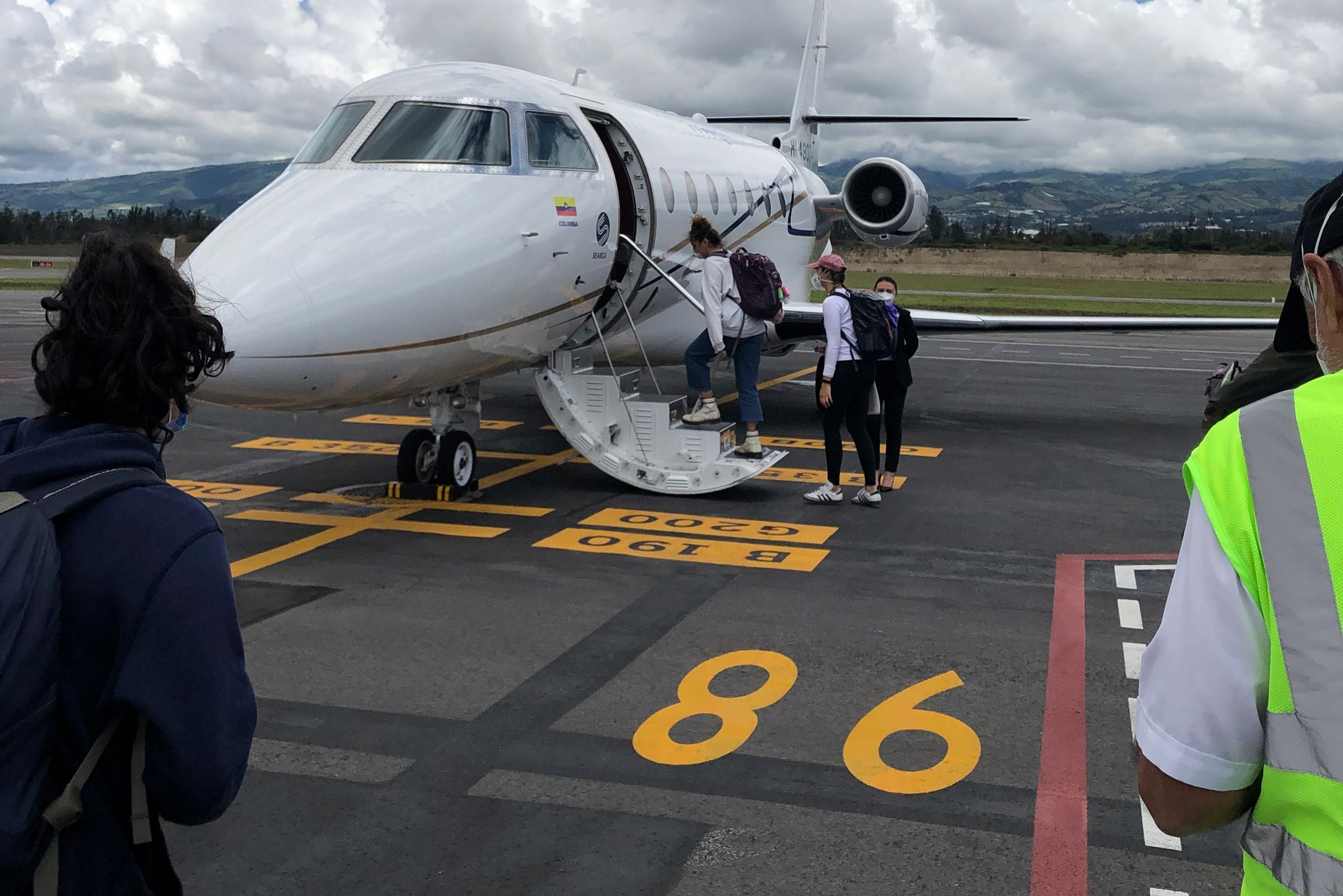 Students on BU's Study Abroad in Quito, Ecuador boarded a chartered flight home after a frantic week of trying to depart.