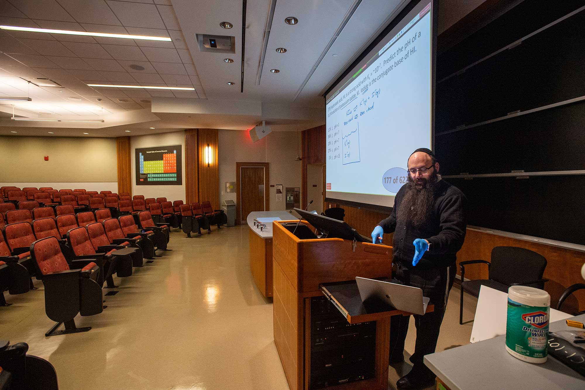Senior Lecturer in Chemistry Binyomin Abrams gives a remote lecture using a laptop and his smart-podium at Boston University.