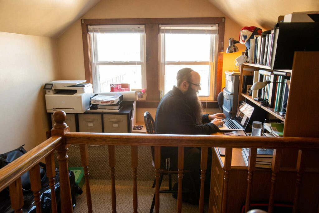 Senior Lecturer in Chemistry at Boston University, Binyomin Abrams, holds remote office hours from his home in Brighton, Mass.