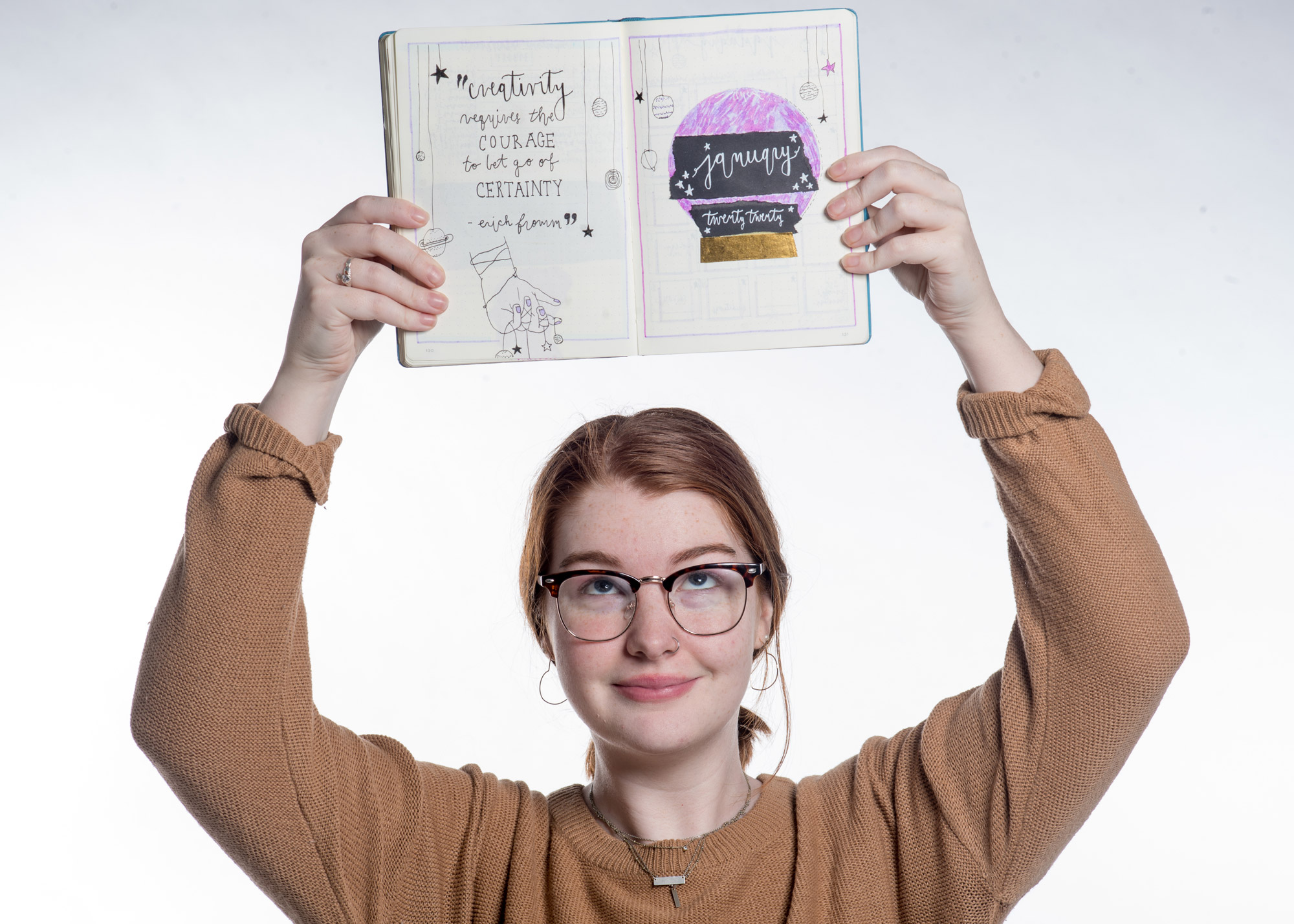 A photo of Abbey McCracken with her bullet journal