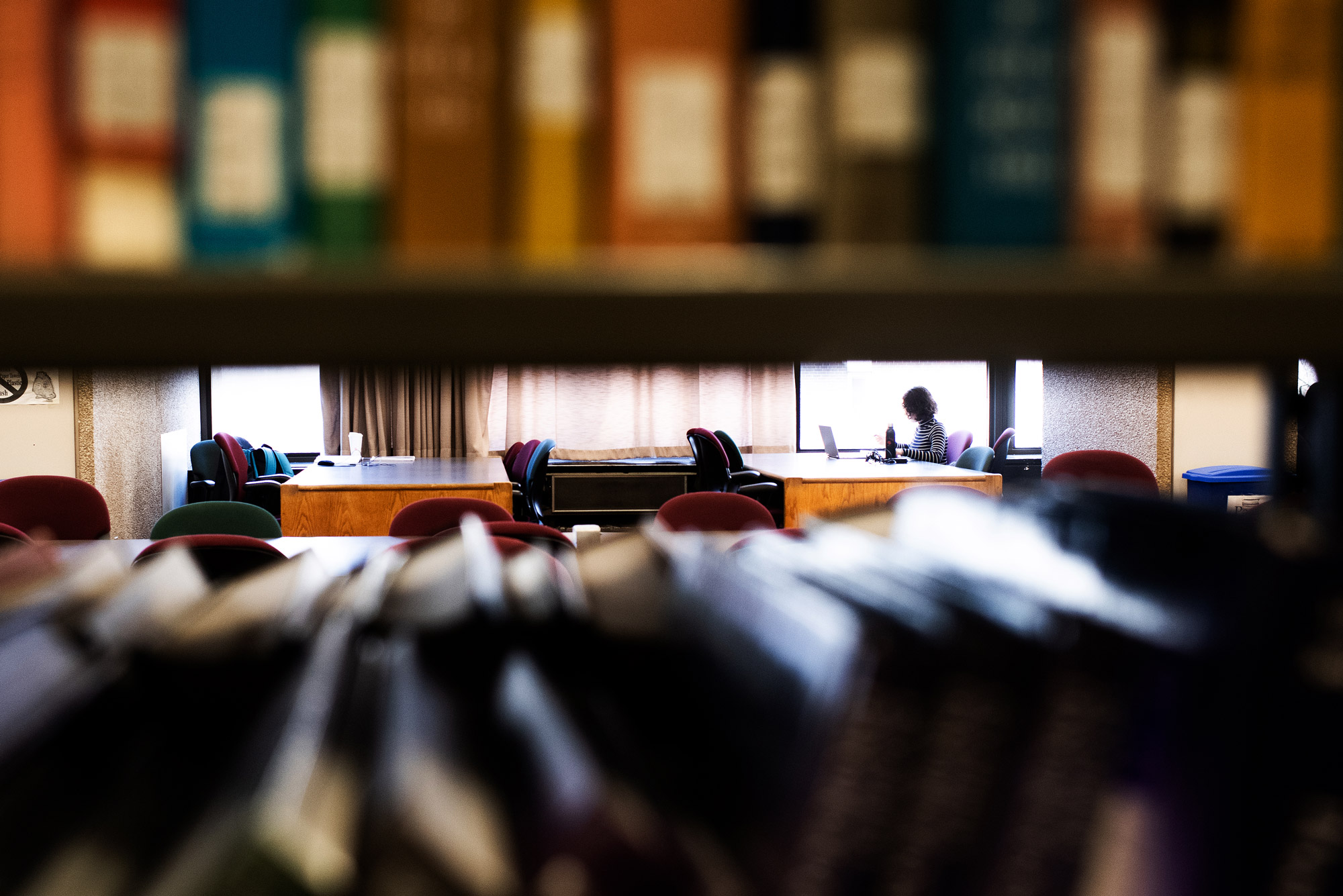 A photo of a student studying in Mugar library