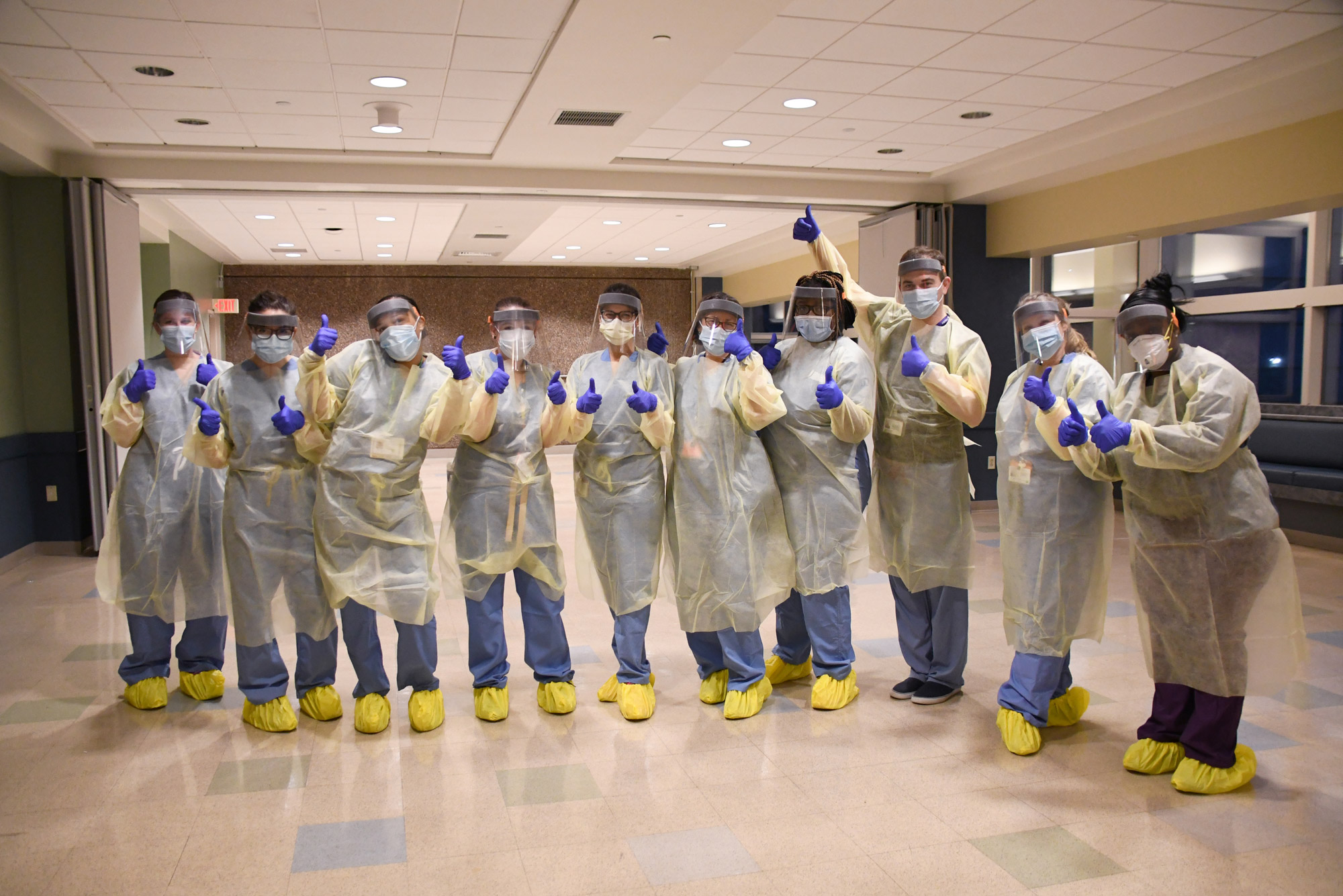 Members of the medical team at the Newton Pavilion COVID-19 recuperation unit for homeless patients, after putting on personal protective equipment for the unit's opening on April 9, 2020.