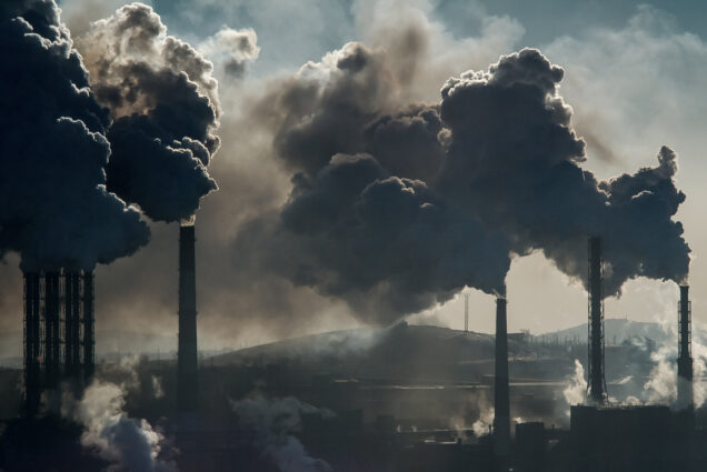 A photo of smokestacks spouting smoke