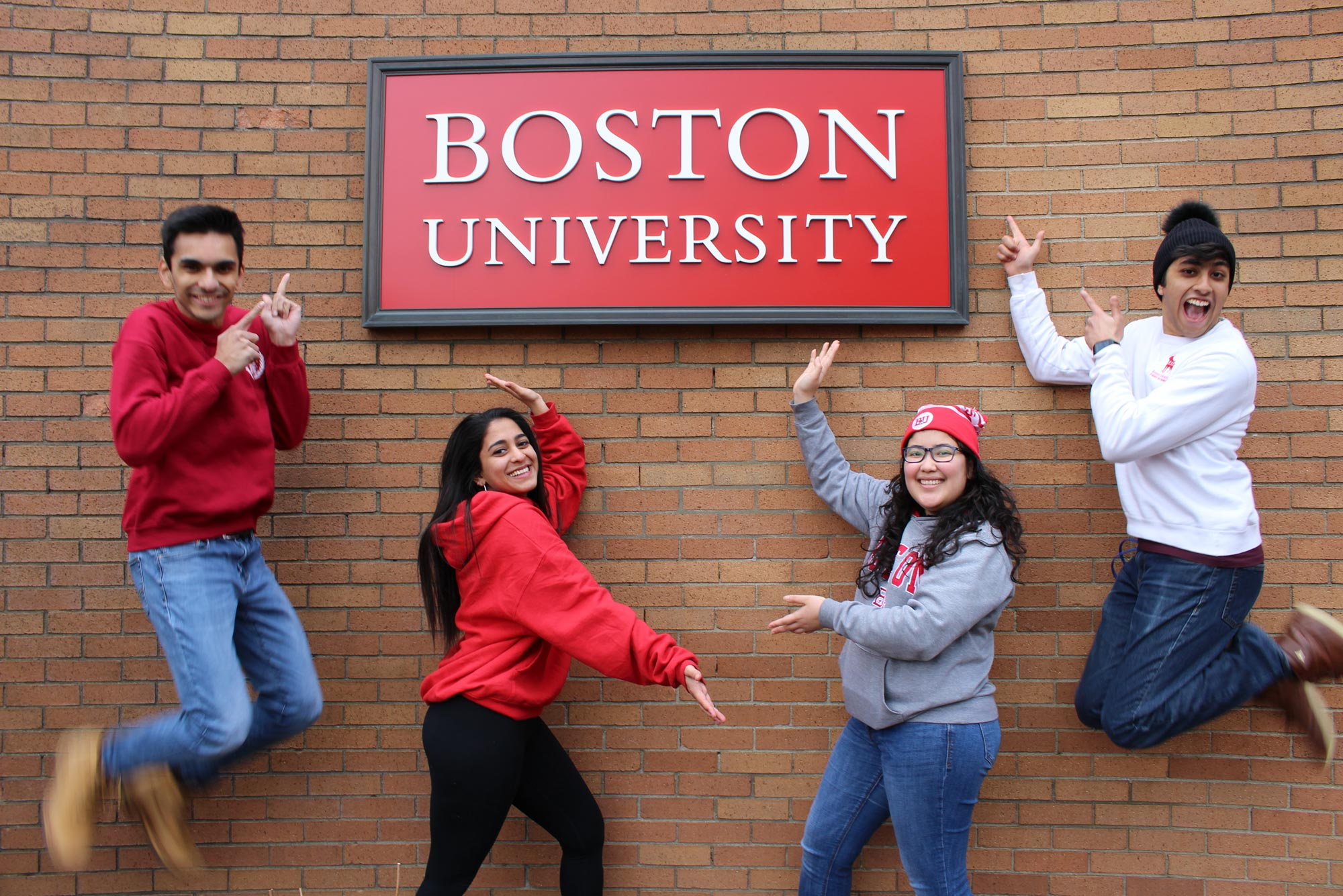 Photo of the students of the ConnectBU slate posing in front of a Boston University sign; the slate includes: President Aditya Jain (ENG'21), Executive VP Soumya Malhotra (CAS'21, Sargent '21), VP Finance Mariafernanda Hernandez (ENG'21), and VP Internal Affairs Hessann Farooqi (CAS'22).