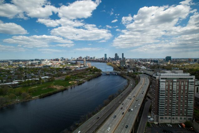 Photo of the Charles River from the 26th floor of Student Village 2 May 7. Blue skies with puffy clouds are seen, as well as Storrow Drive and the Boston skyline.