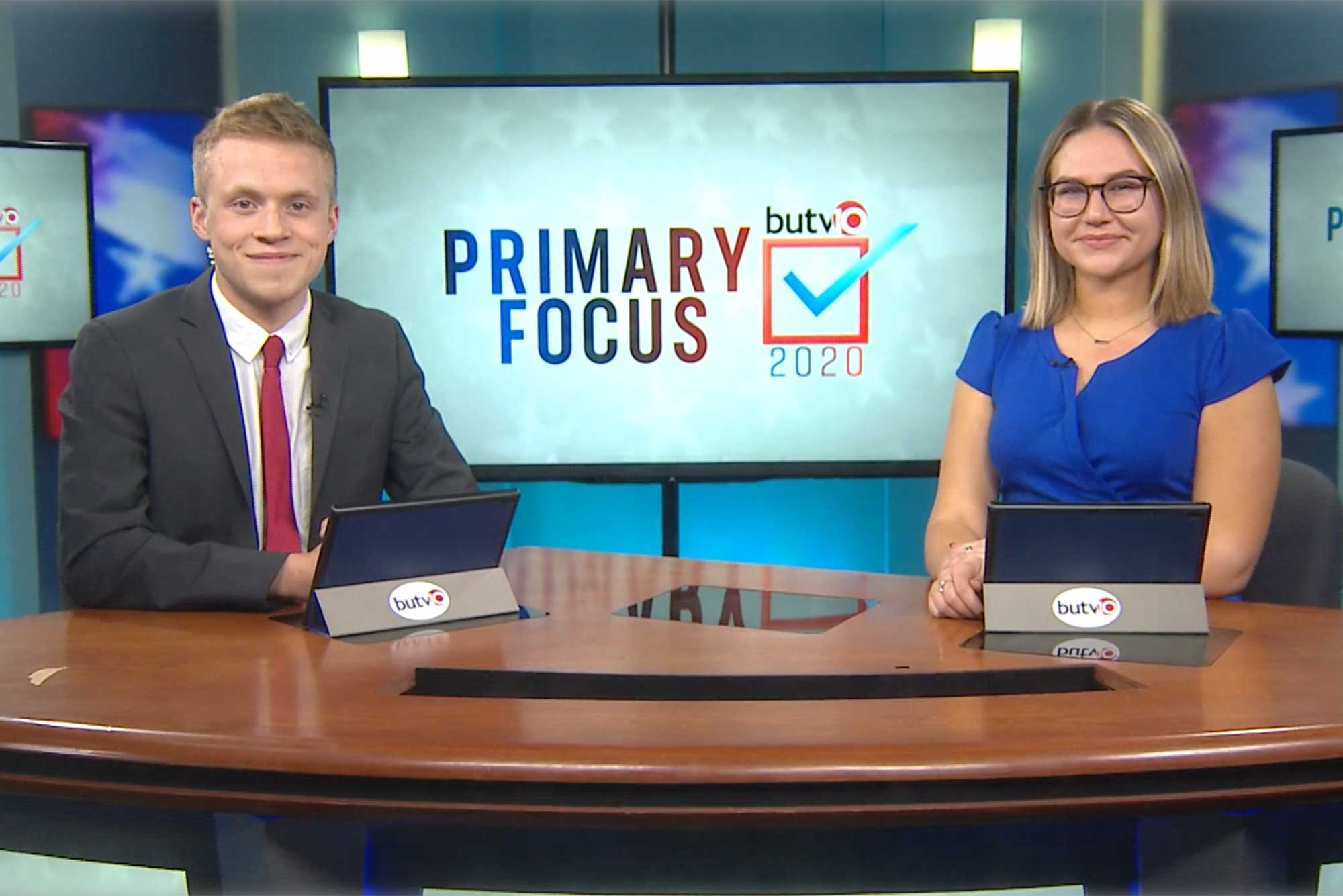 News anchors for BUTV10 show Primary Focus on the set.