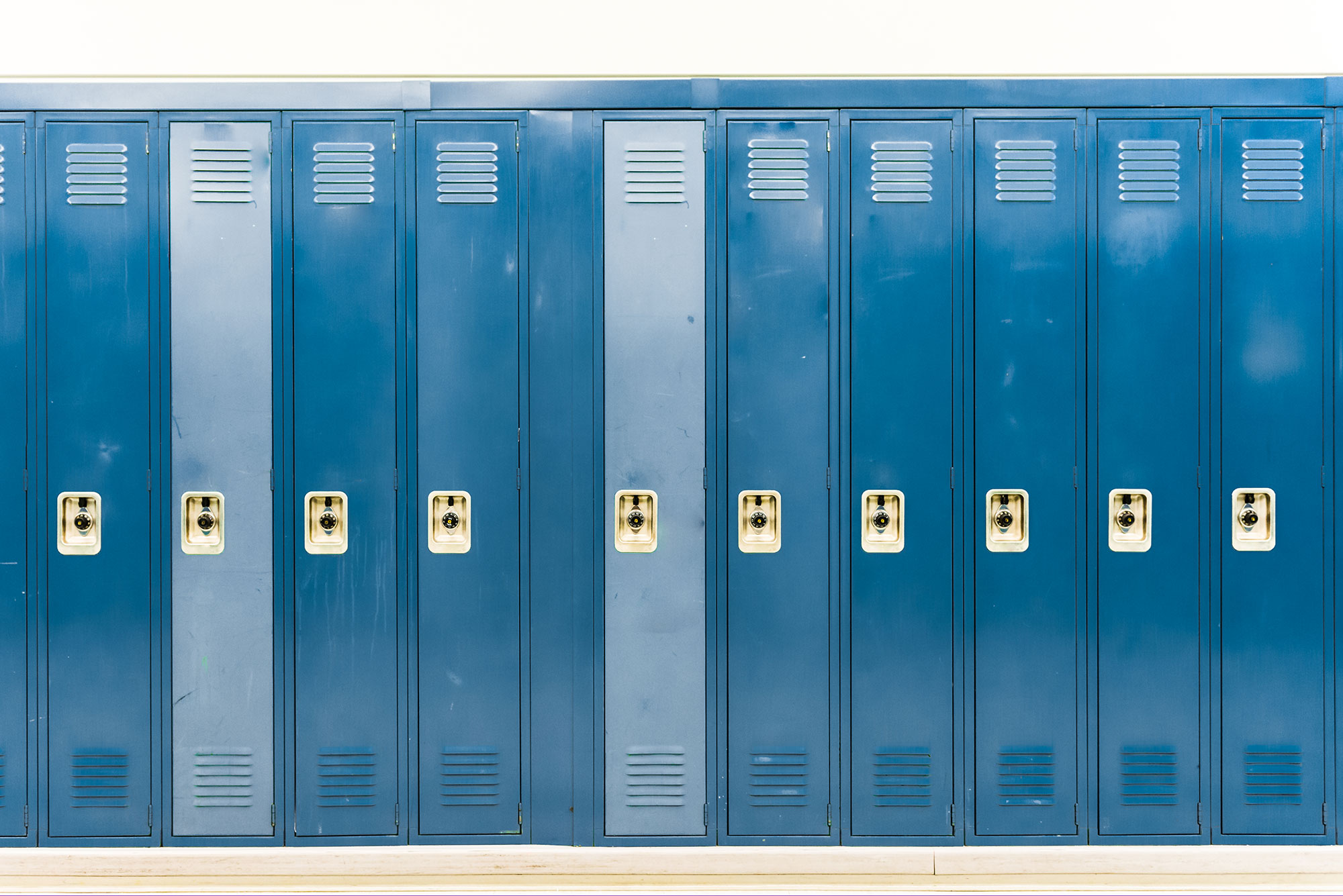 Image of dark and light blue lockers in a row.