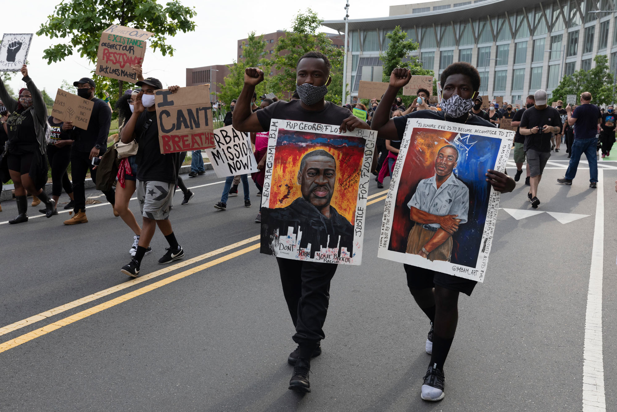 On Saturday, June 6, people carried signs protesting police brutality at the University of Massachusetts in Boston after the death of George Floyd.