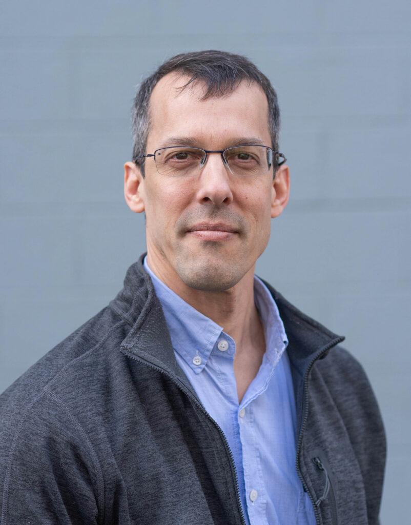 A portrait photograph of Eric Kolaczyk