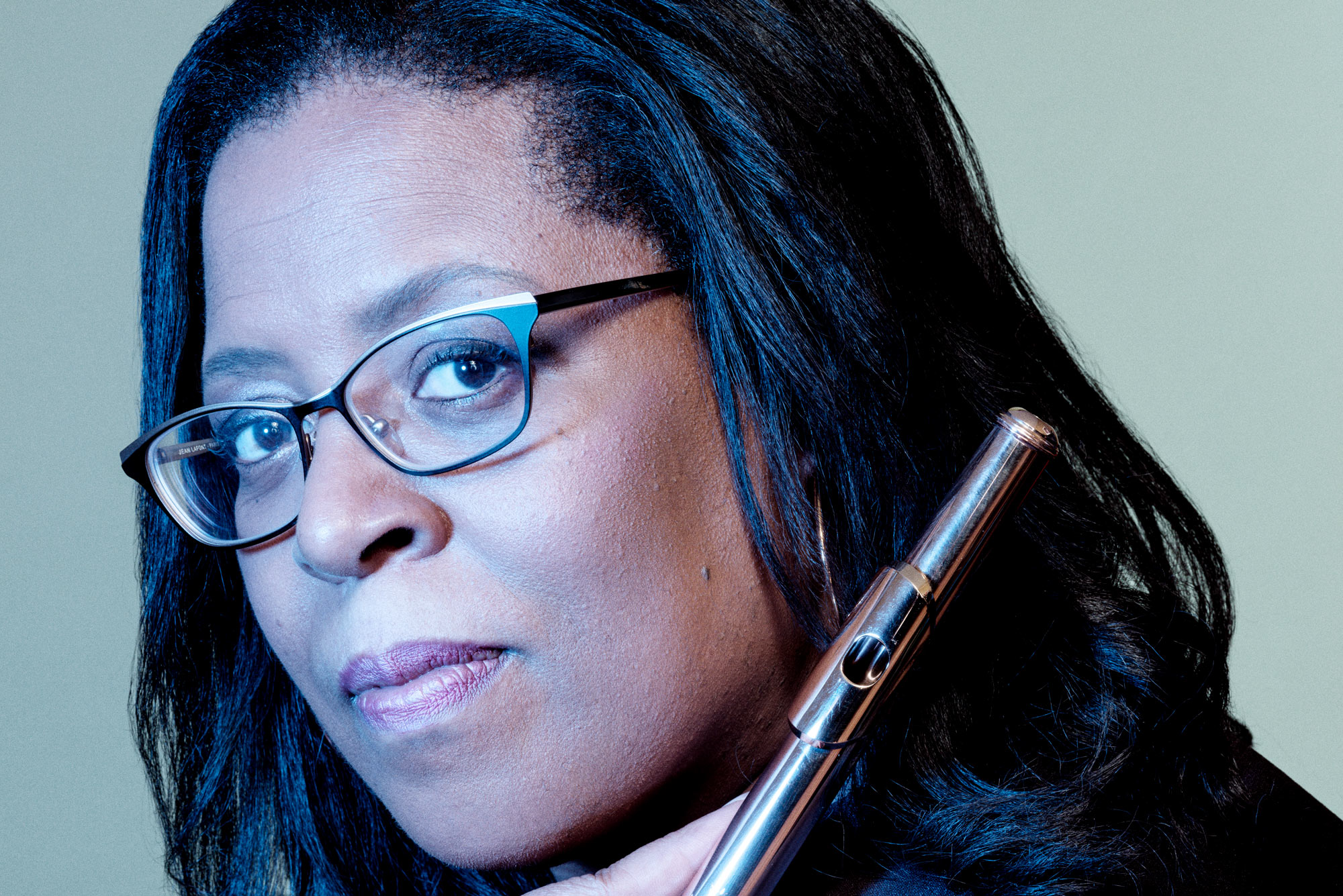 A portrait photo of Valerie Coleman with her flute