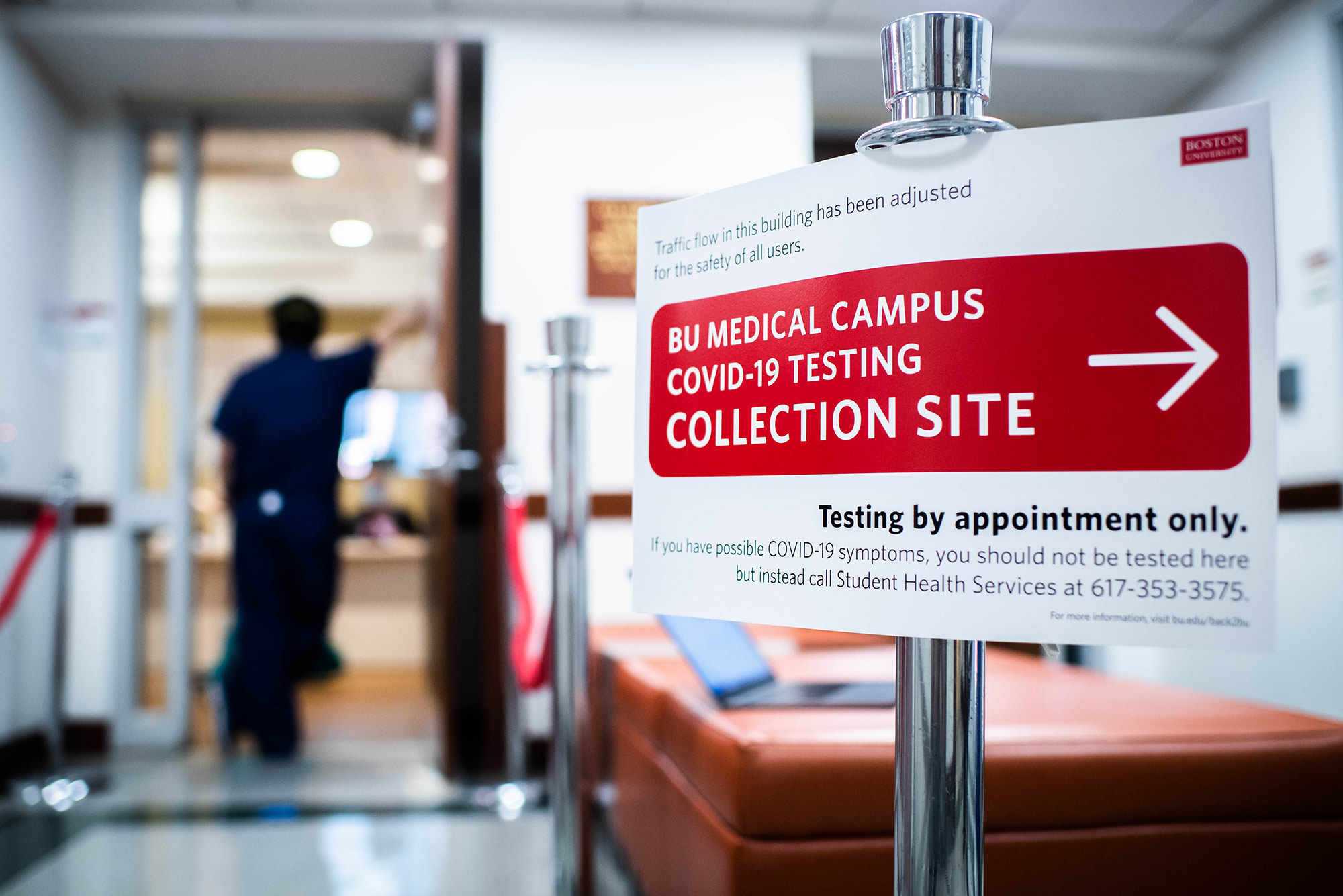 "Sign at the the Covid-19 testing collection site on the BU Medical Campus on July 27, 2020. Sign reads ""BU Medical Campus COVID-19 Testing Collection Site"" in a red box with an arrow pointing to the right. Bolded text below reads ""Testing by appointment only."""