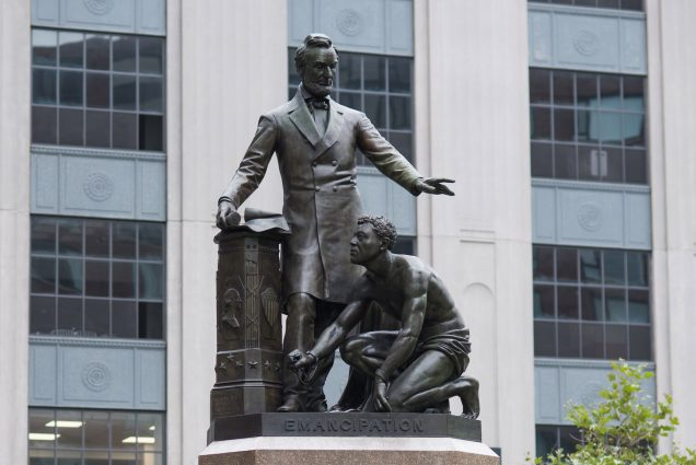 The Emancipation Group statue in Boston's Park Square. The statue shows Abraham Lincoln towering over a crouched and half-naked formerly enslaved man, Archer Alexander.