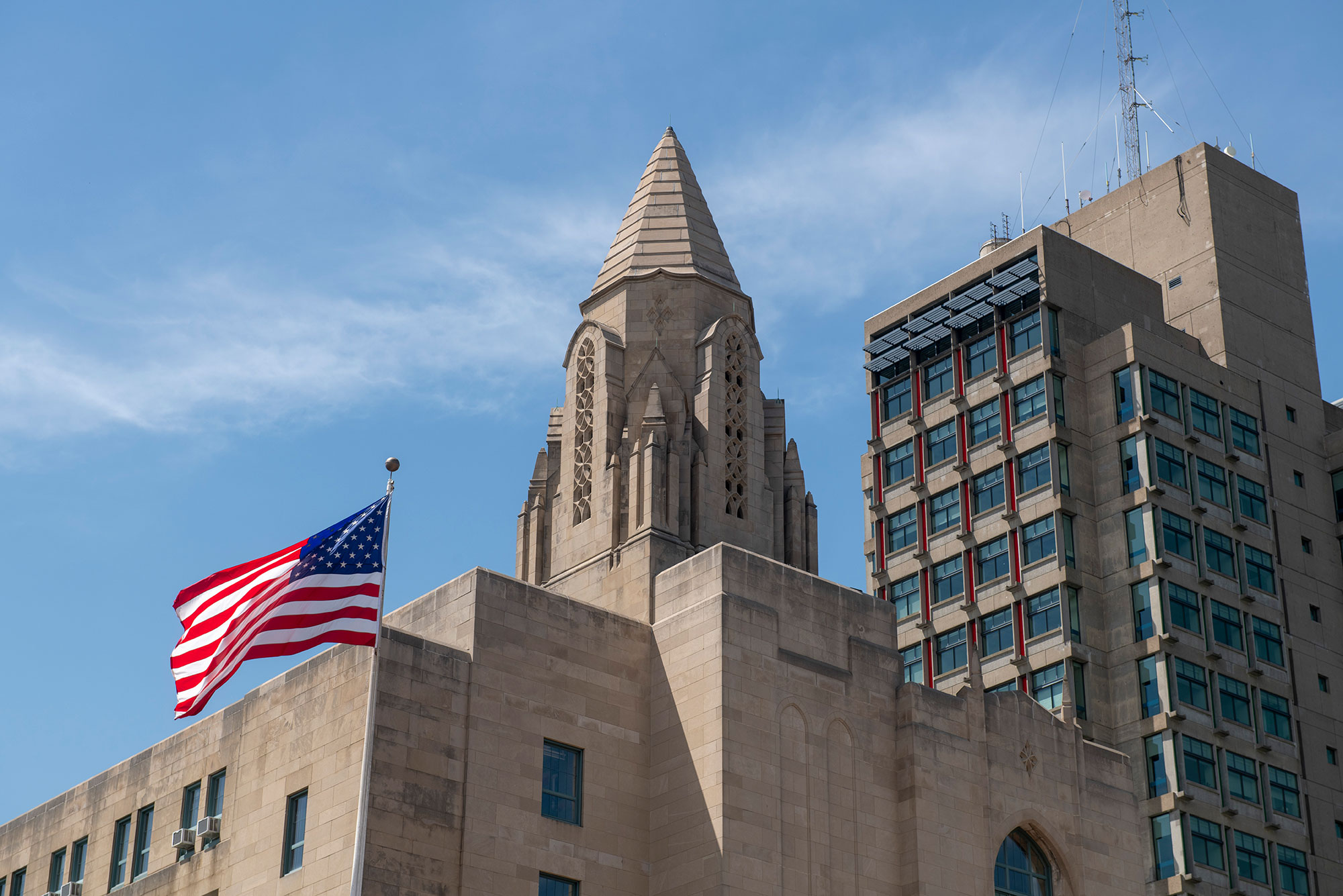 Stock image of Boston University campus on June 7, 2019. School of Law tower and the STH tower with the American flag flying.