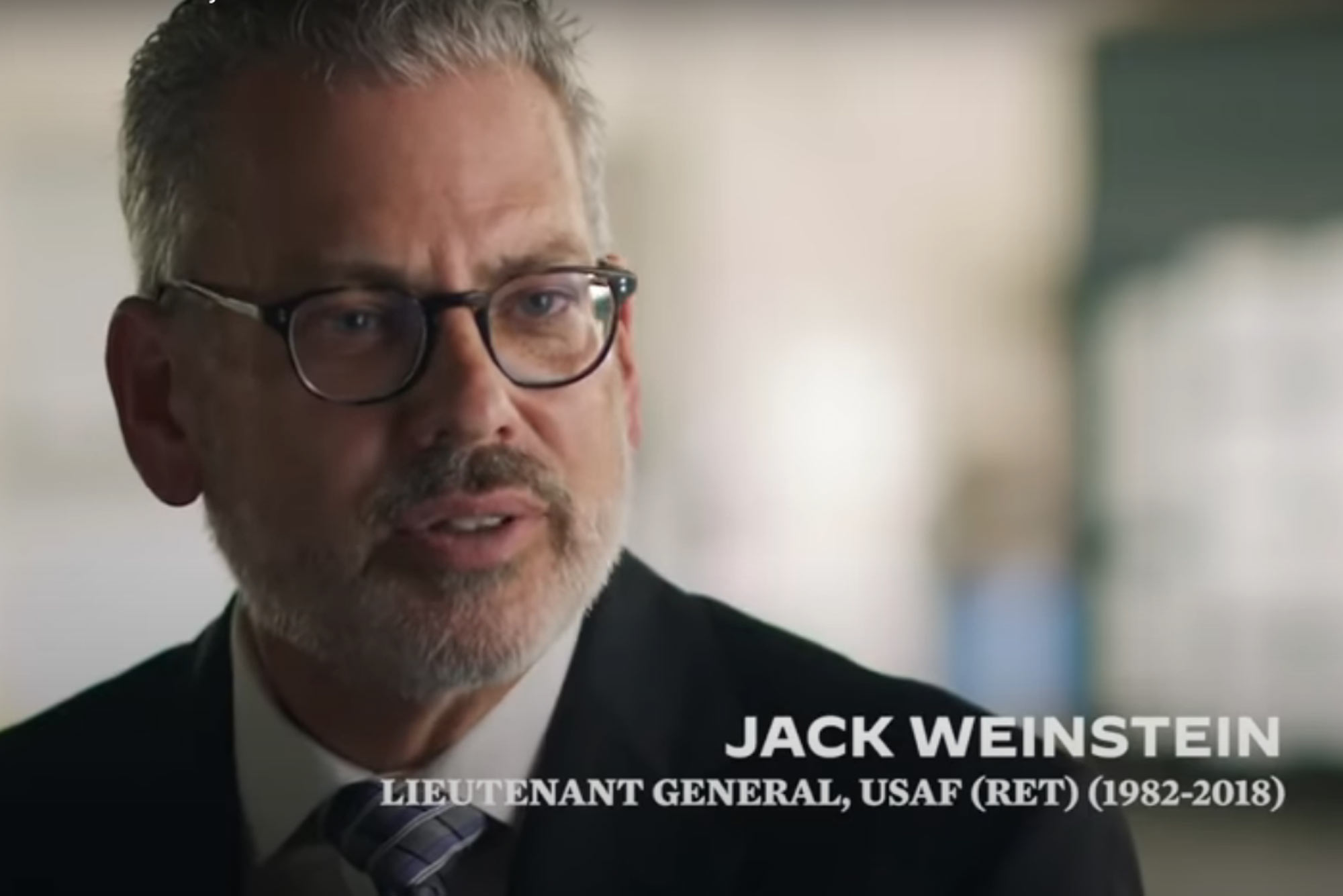 "A screenshot of Jack Weinstein from a DNC video on national security. Text reads ""Jack Weinstein, Lieutenant General, USAF (Ret.) (1982-2018)"