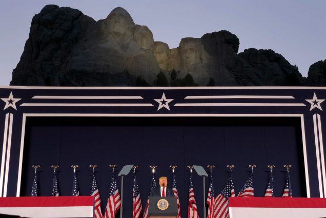 President Donald Trump speaks at Mount Rushmore National Monument Friday, July 3, 2020, in Keystone, S.D. Trump stands at the podium and the faces of Mt. Rushmore are seen behind him.