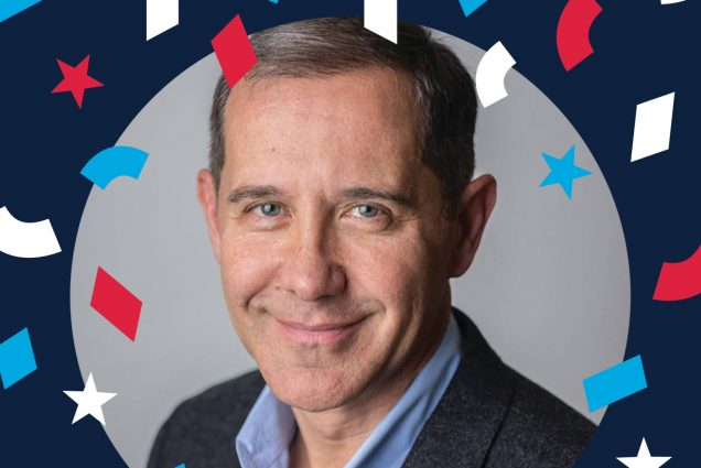 Image shows a headshot of Joe Solmonese (COM'87), CEO of the Democratic National Convention in a circle, with a dark blue border with red, white, and blue confetti around him.