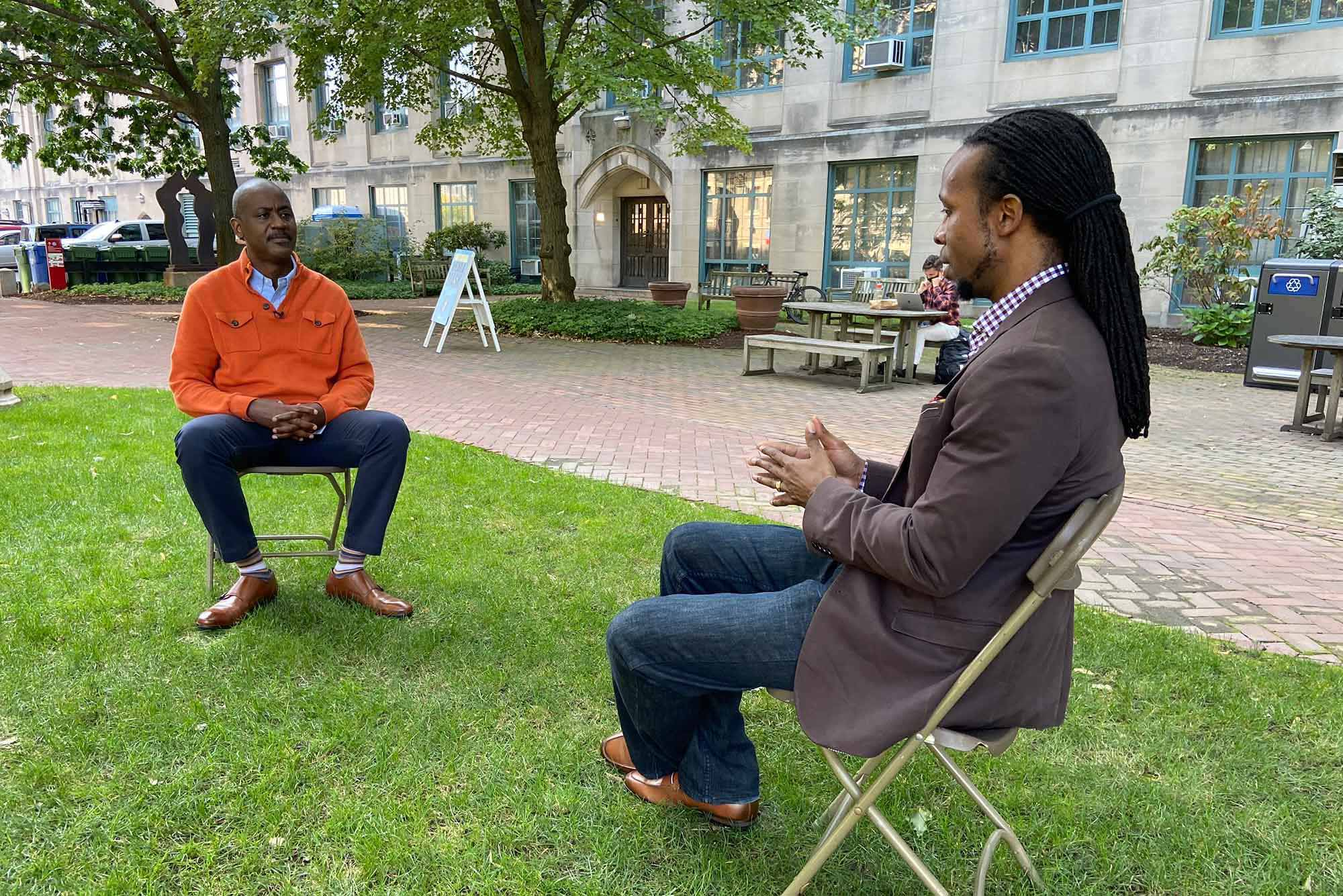 Otis Rolley III, Senior Vice President, U.S. Equity and Economic Opportunity Initiative at The Rockefeller Foundation, and Ibram X. Kendi, Director and Founder of the Boston University Center for Antiracist Research, in a discussion outdoors at Boston University. Photo courtesy of The Rockefeller Foundation