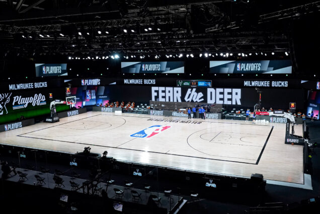 A photo of n empty court at the scheduled start of an NBA basketball first round playoff game between the Milwaukee Bucks and the Orlando Magic, Wednesday, Aug. 26, 2020, in Lake Buena Vista, Fla.