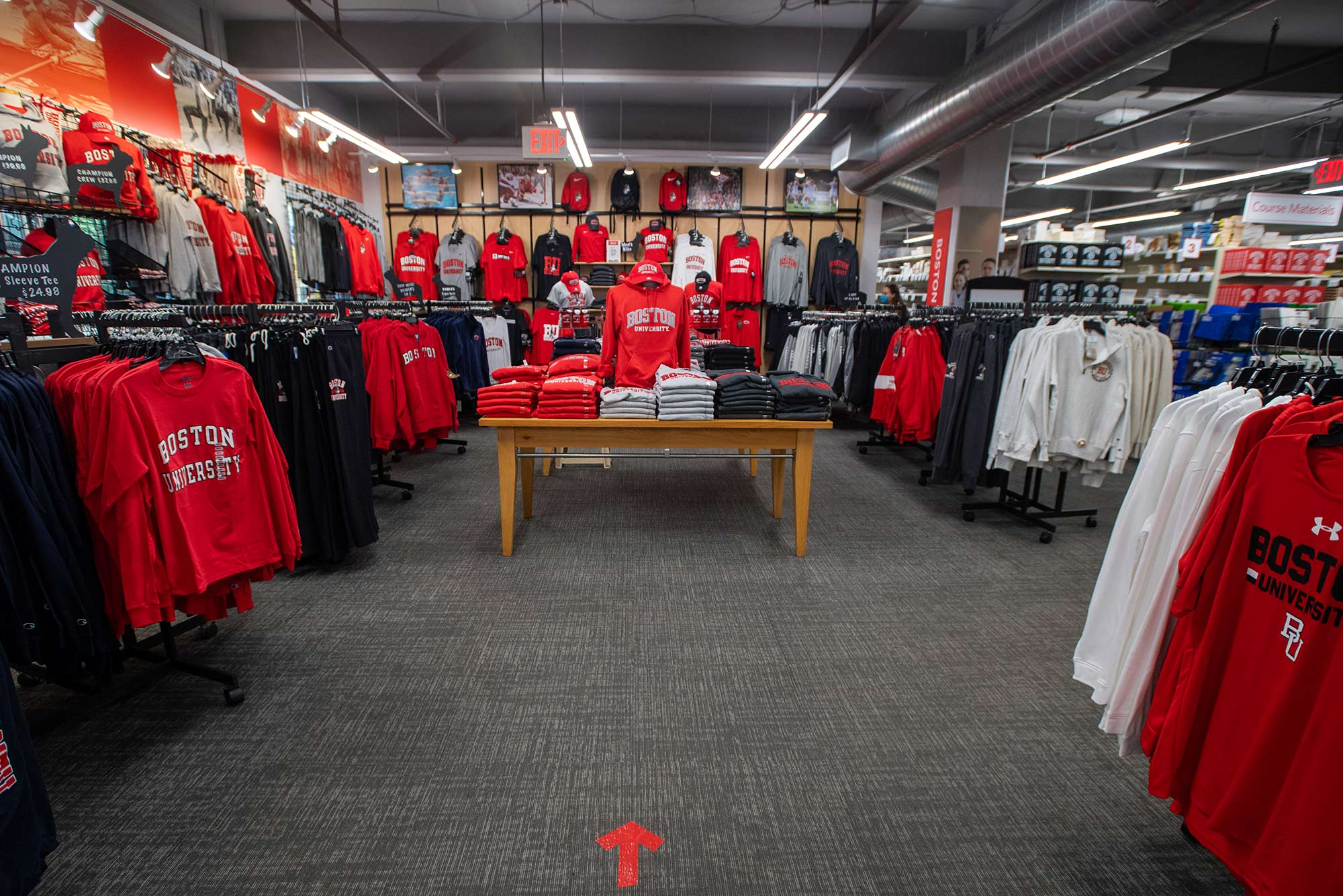 Photo of the BU merchandise section of Barnes and Nobles on August 19. A directional sign on the floor in red tape directs traffic.