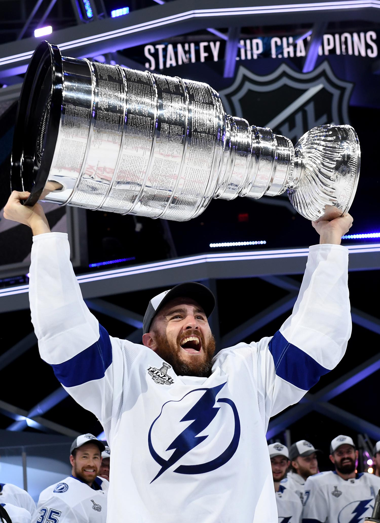 Photo of Kevin Shattenkirk #22 of the Tampa Bay Lightning hoisting the Stanley Cup over his head after the Tampa Bay Lightning defeated the Dallas Stars 2-0 in Game Six of the NHL Stanley Cup Final on September 28, 2020 in Edmonton, Alberta, Canada.